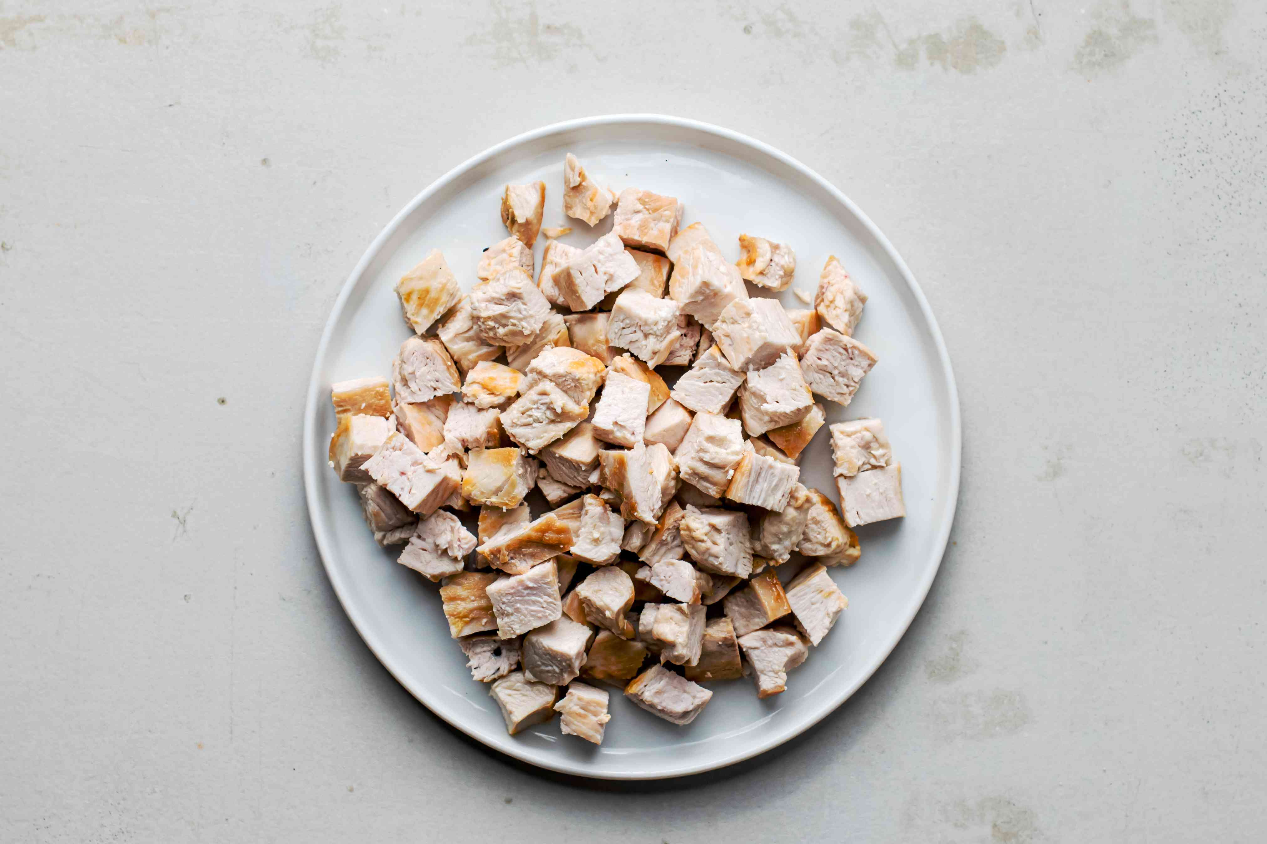 Diced chicken pieces on a white plate
