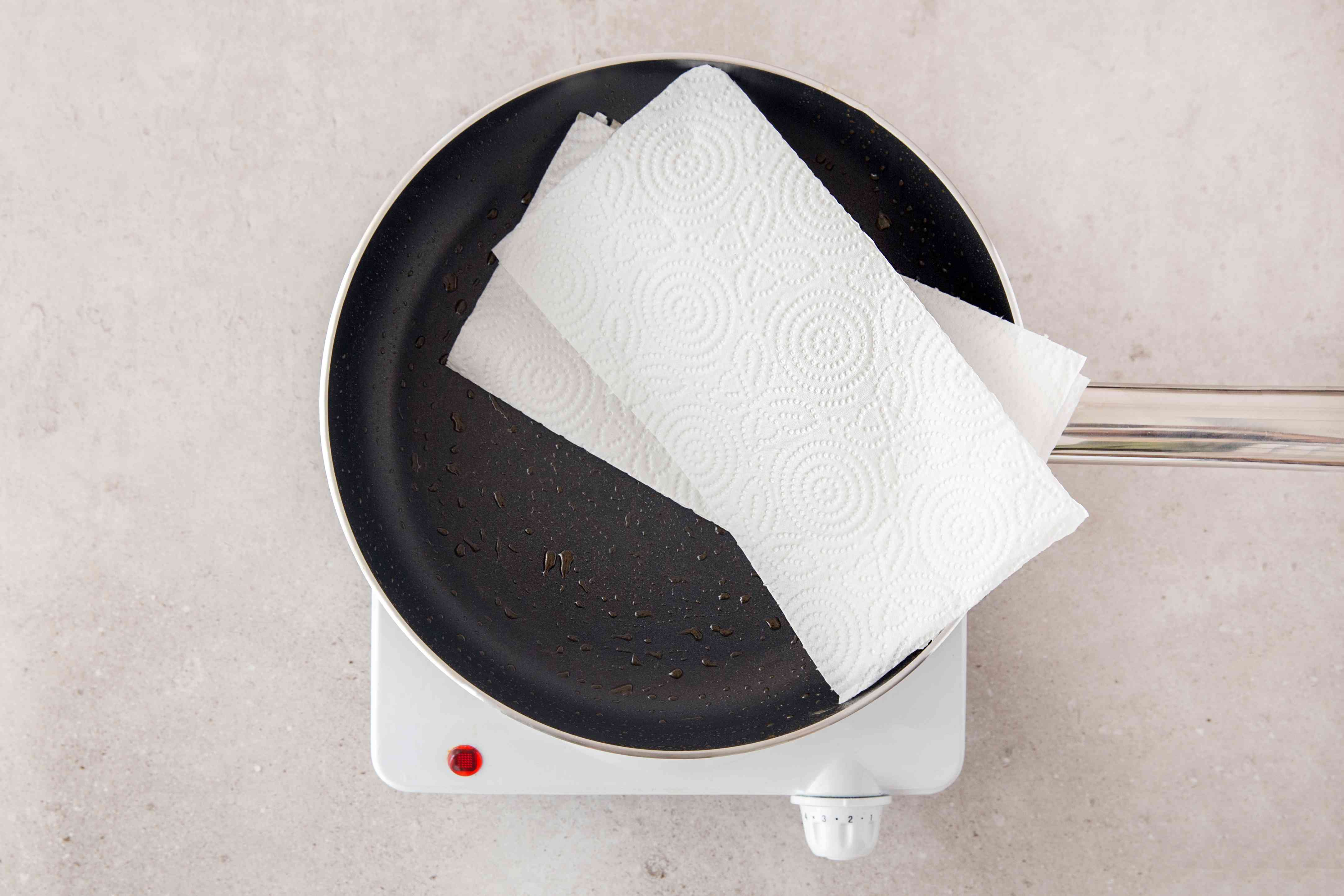 wipe nonstick skillet with paper towels