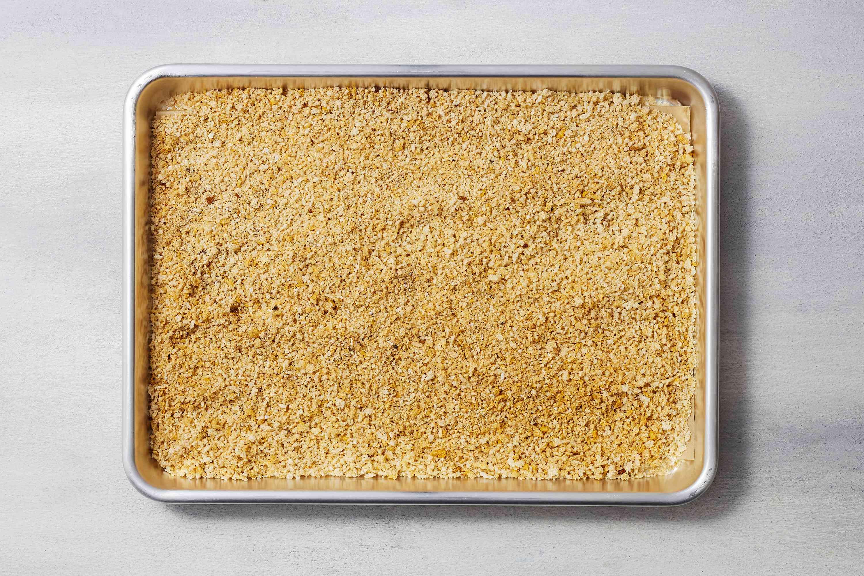 seasoned breadcrumbs on a baking sheet