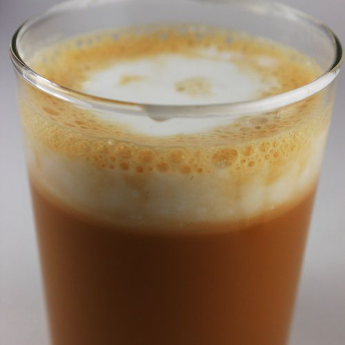 An image of Thai Tea in a clear glass.
