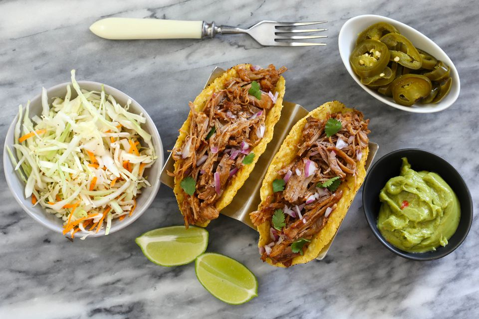 Root beer pulled pork in tacos with slaw and peppers.