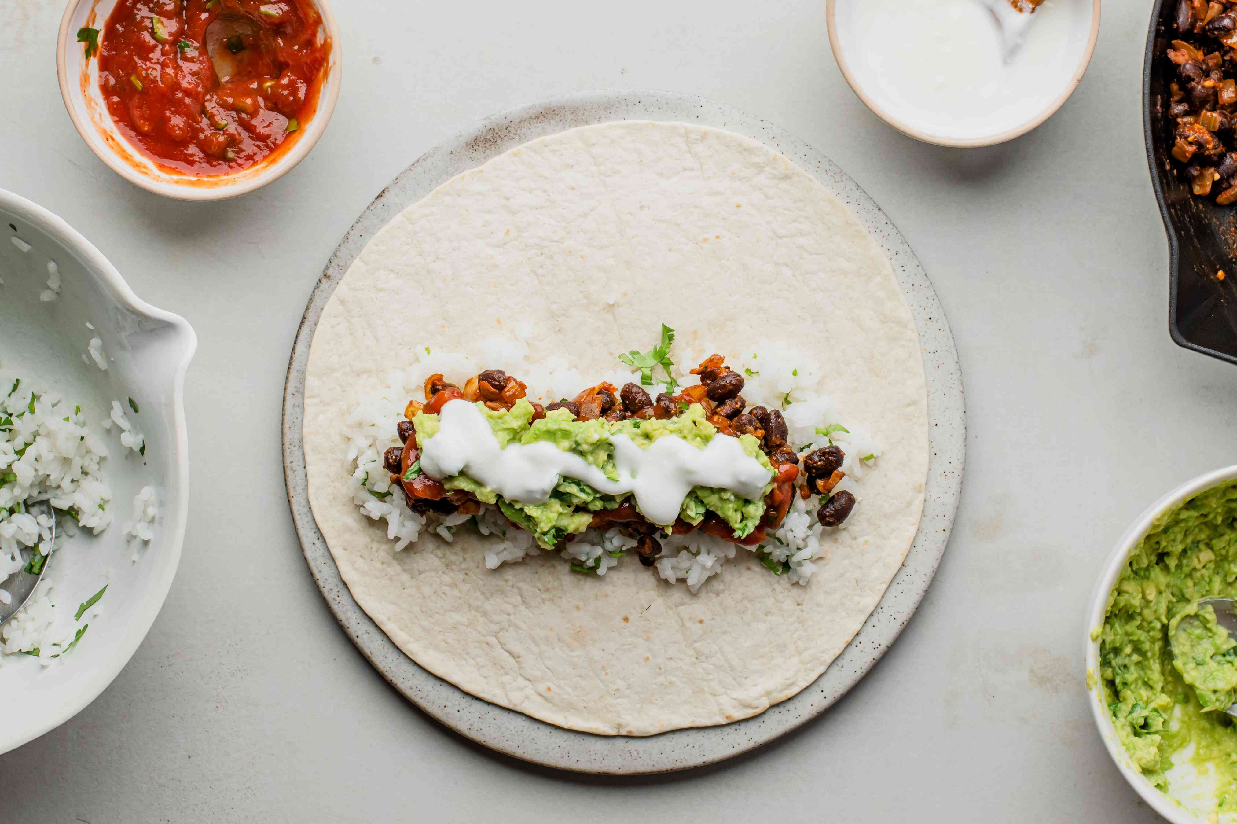 Cilantro-lime rice and black bean mix are added to flour tortillas