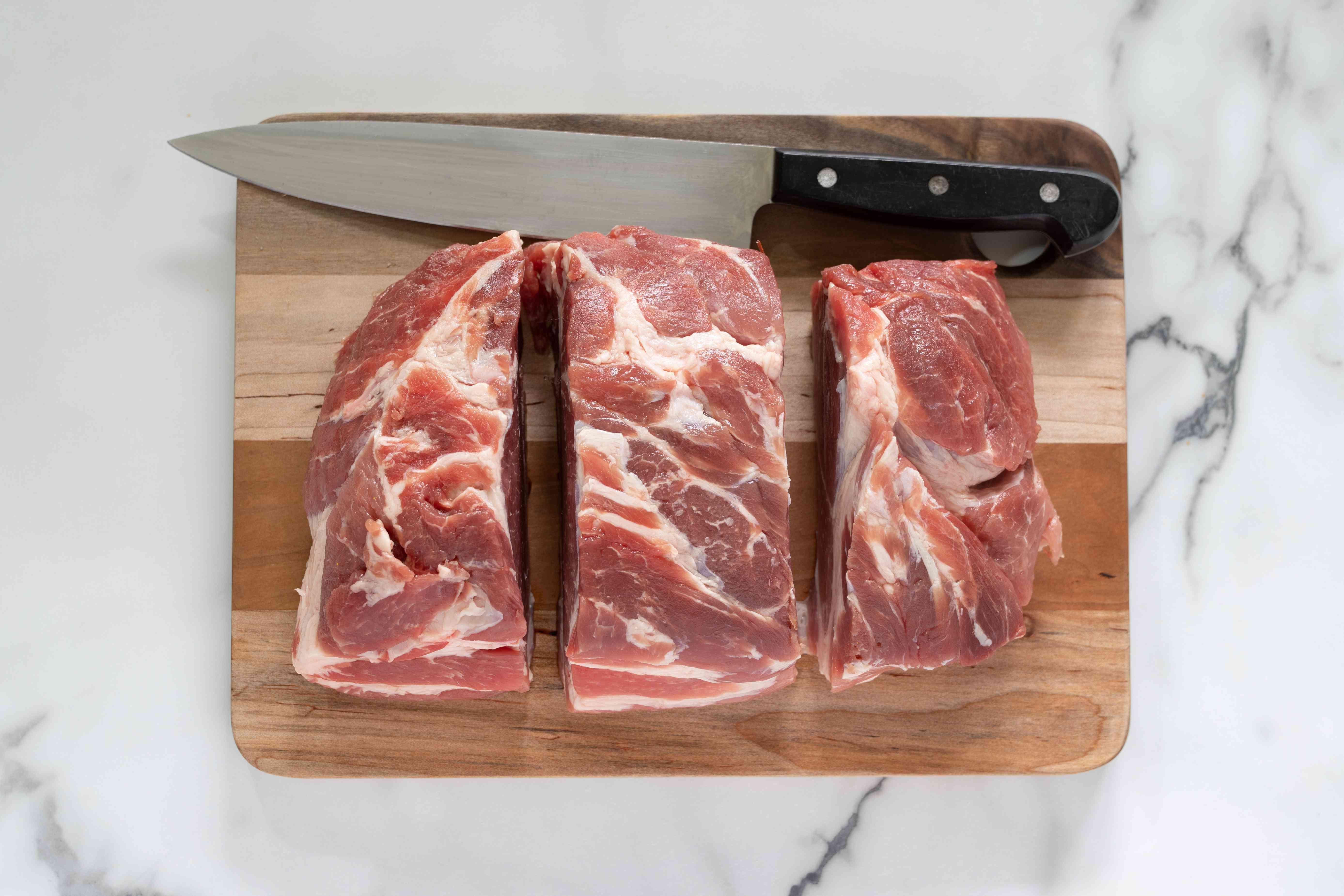 Raw pork shoulder cut into chunks