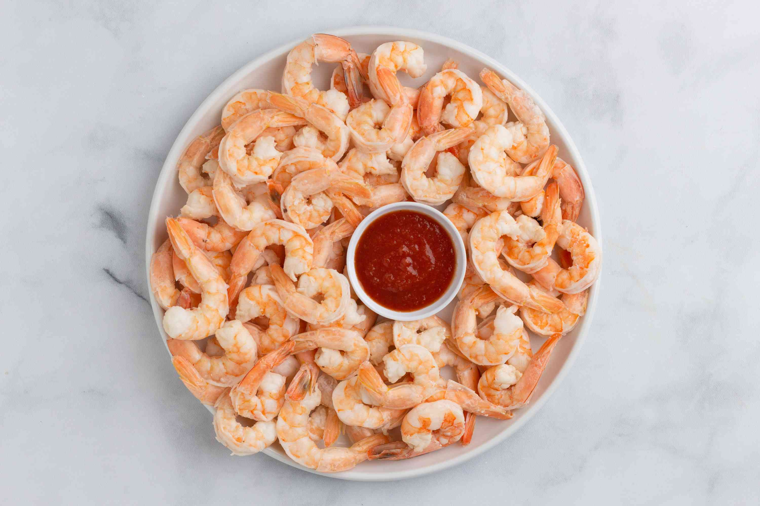 Beer-Steamed Shrimp on a plate, served with sauce