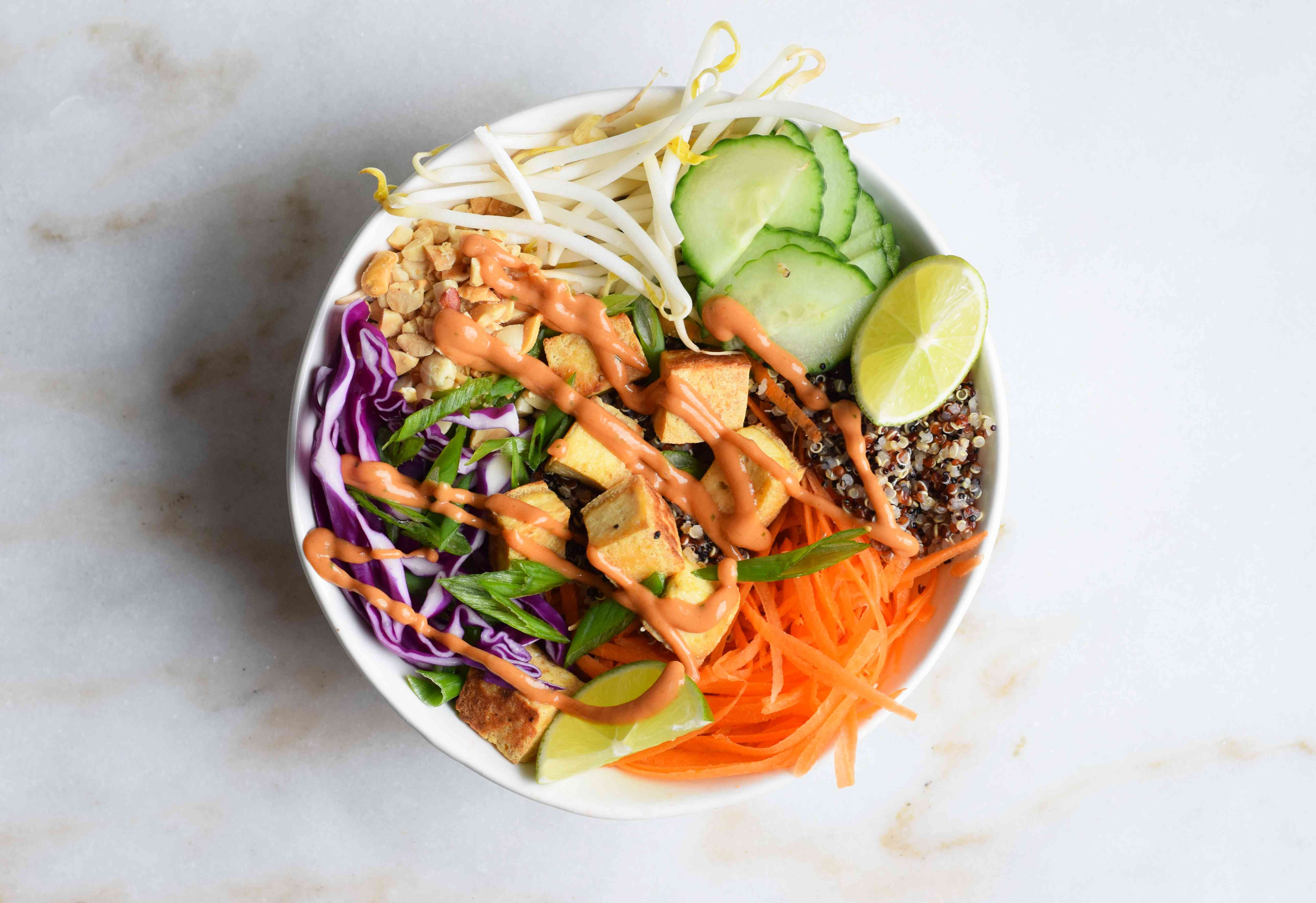 buddha bowls topped with tofu and vegetables