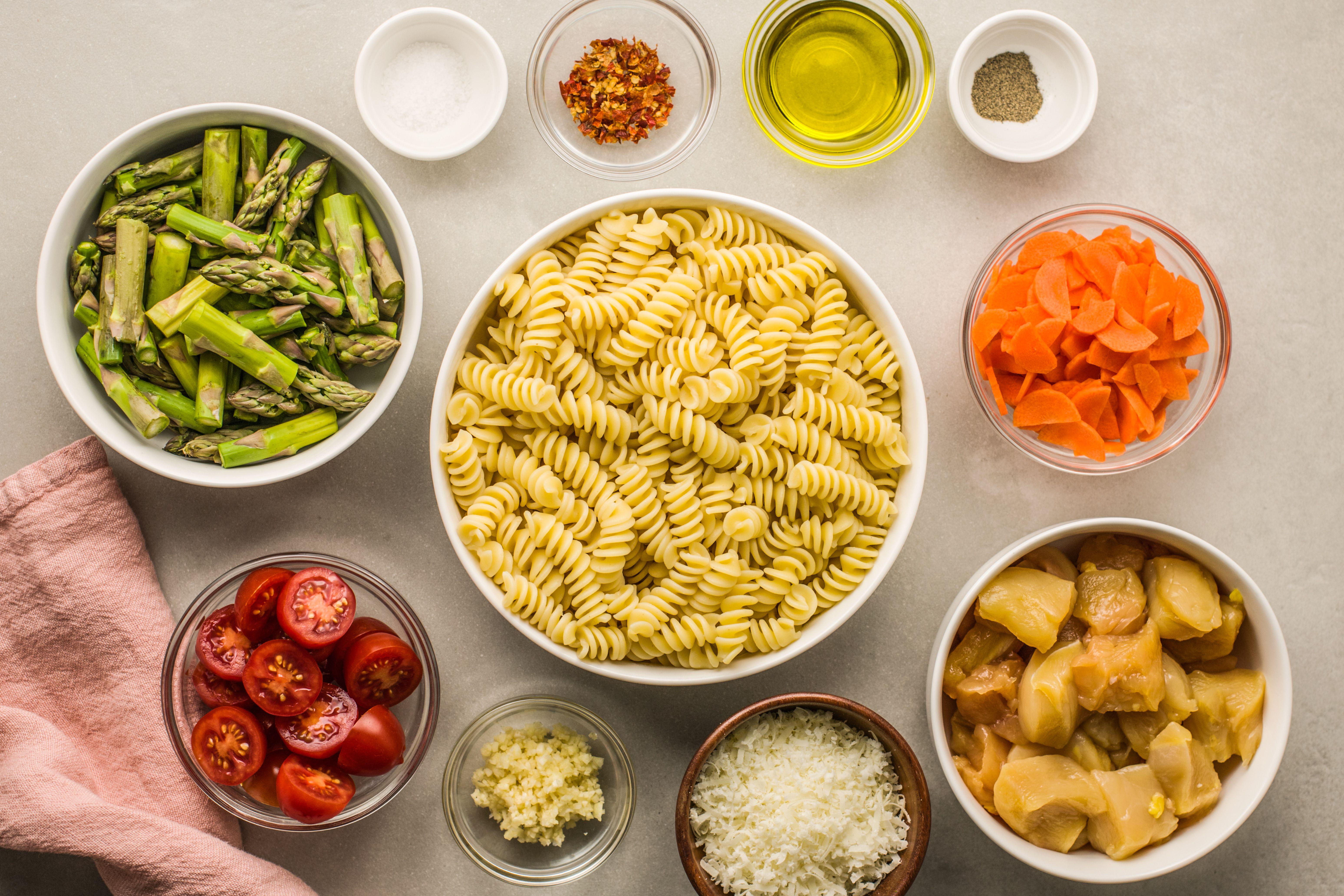Gather the ingredients for chicken pasta primavera
