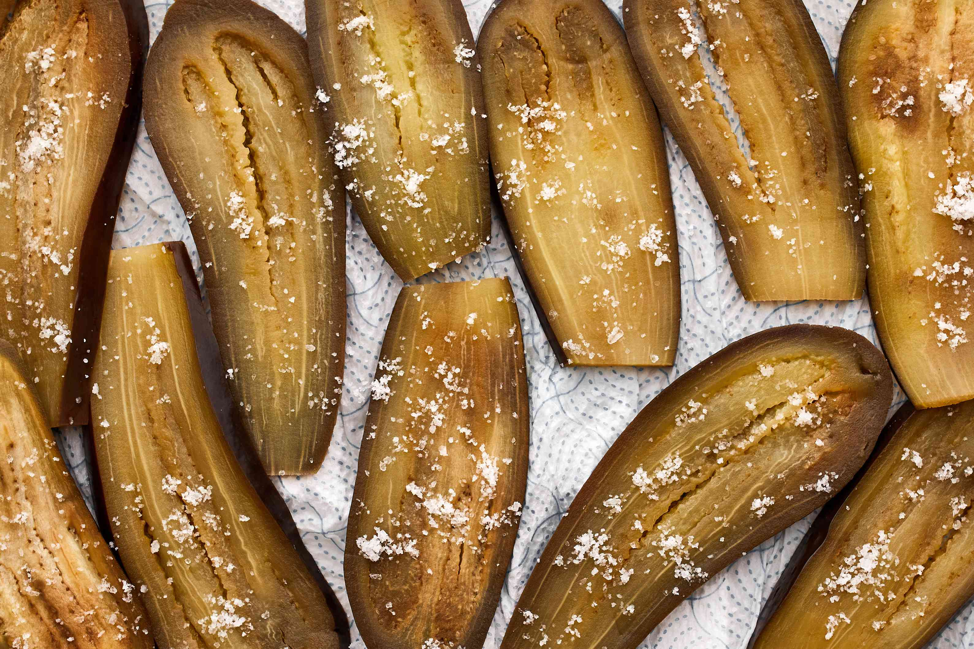 Sprinkle eggplant with 2 teaspoons of salt and place a layer of paper towels