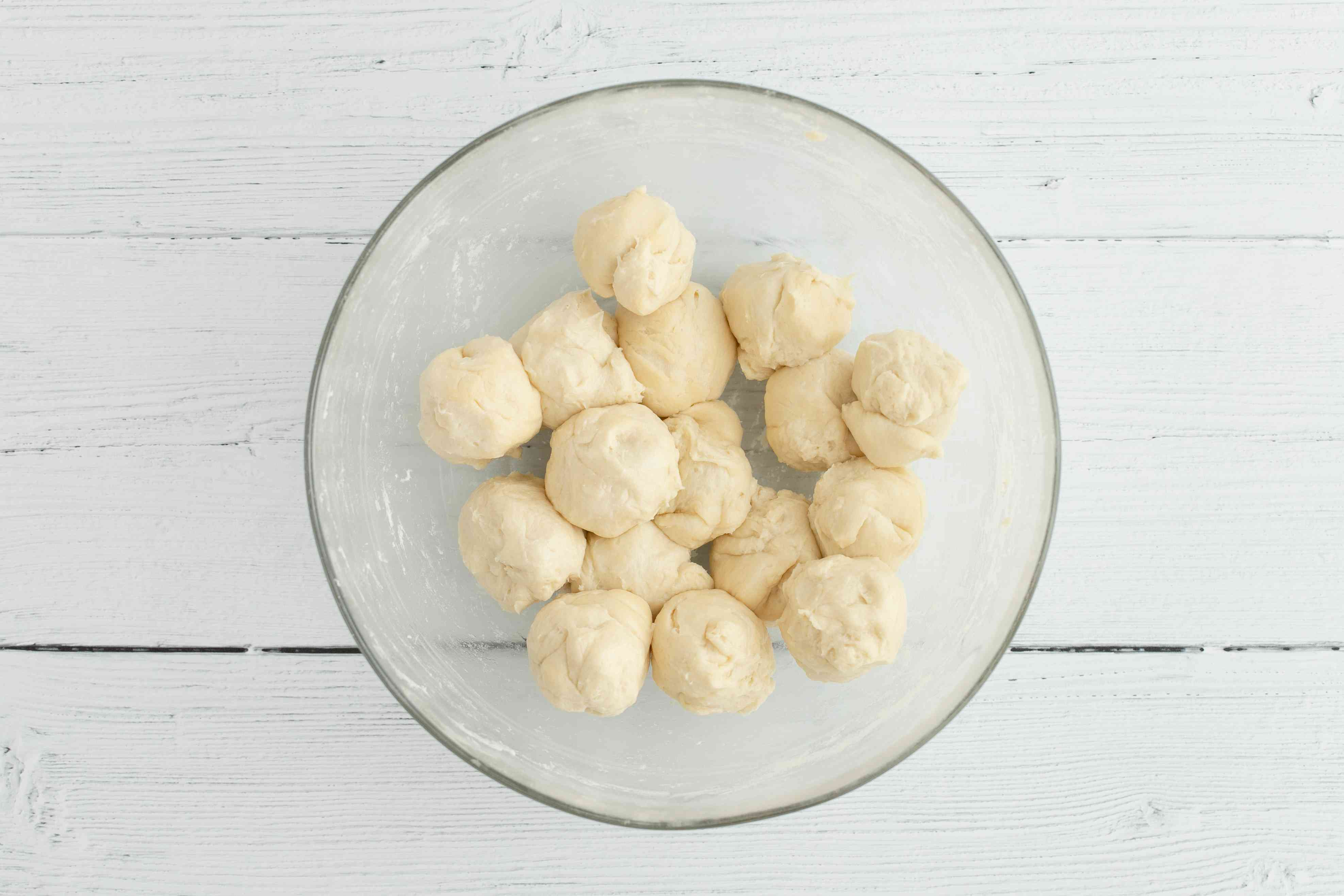 Pastry dough divided into pieces in a bowl