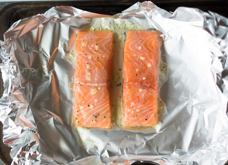 Seasoned salmon fillets in foil.
