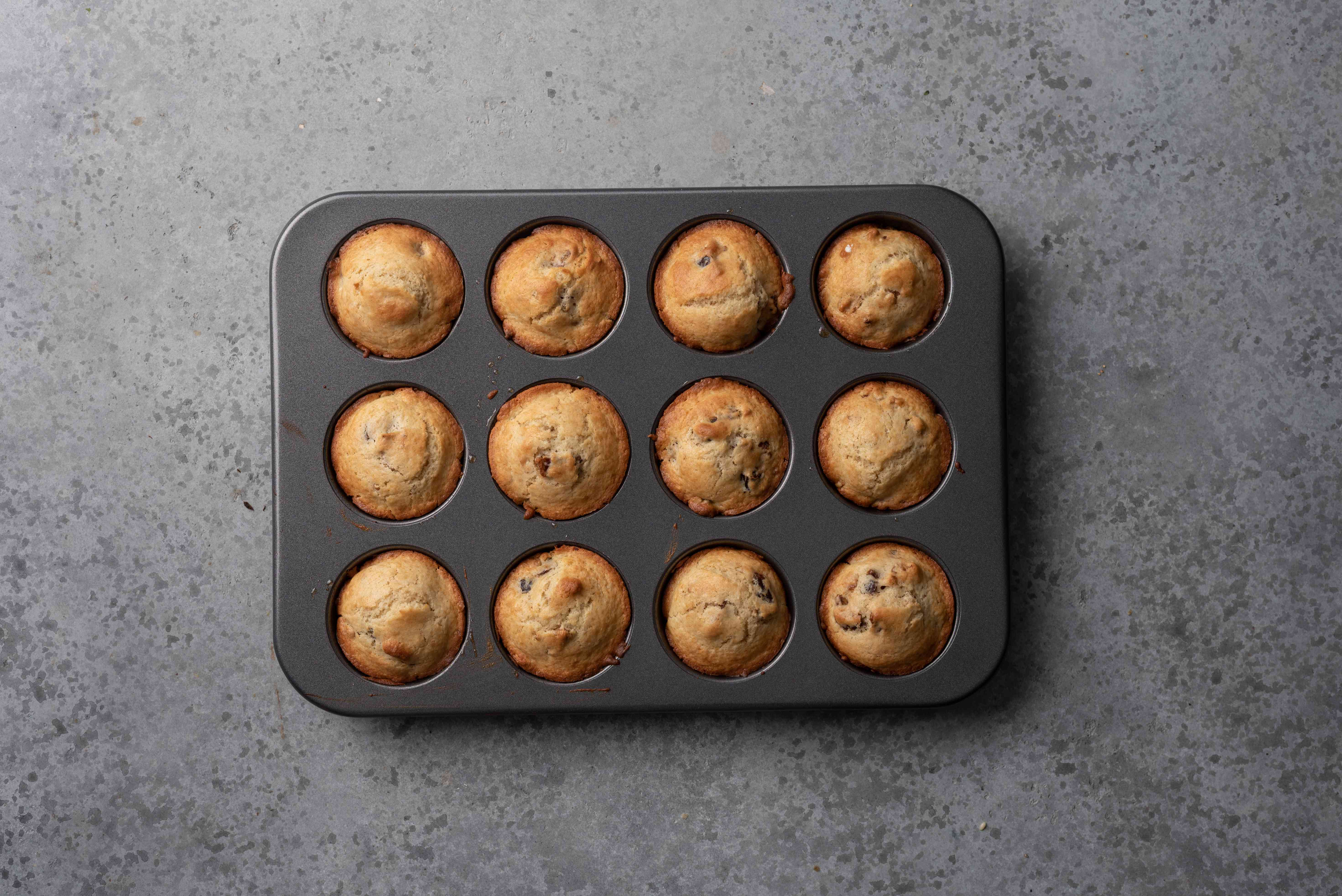 Date Muffins With Walnuts in muffin tins