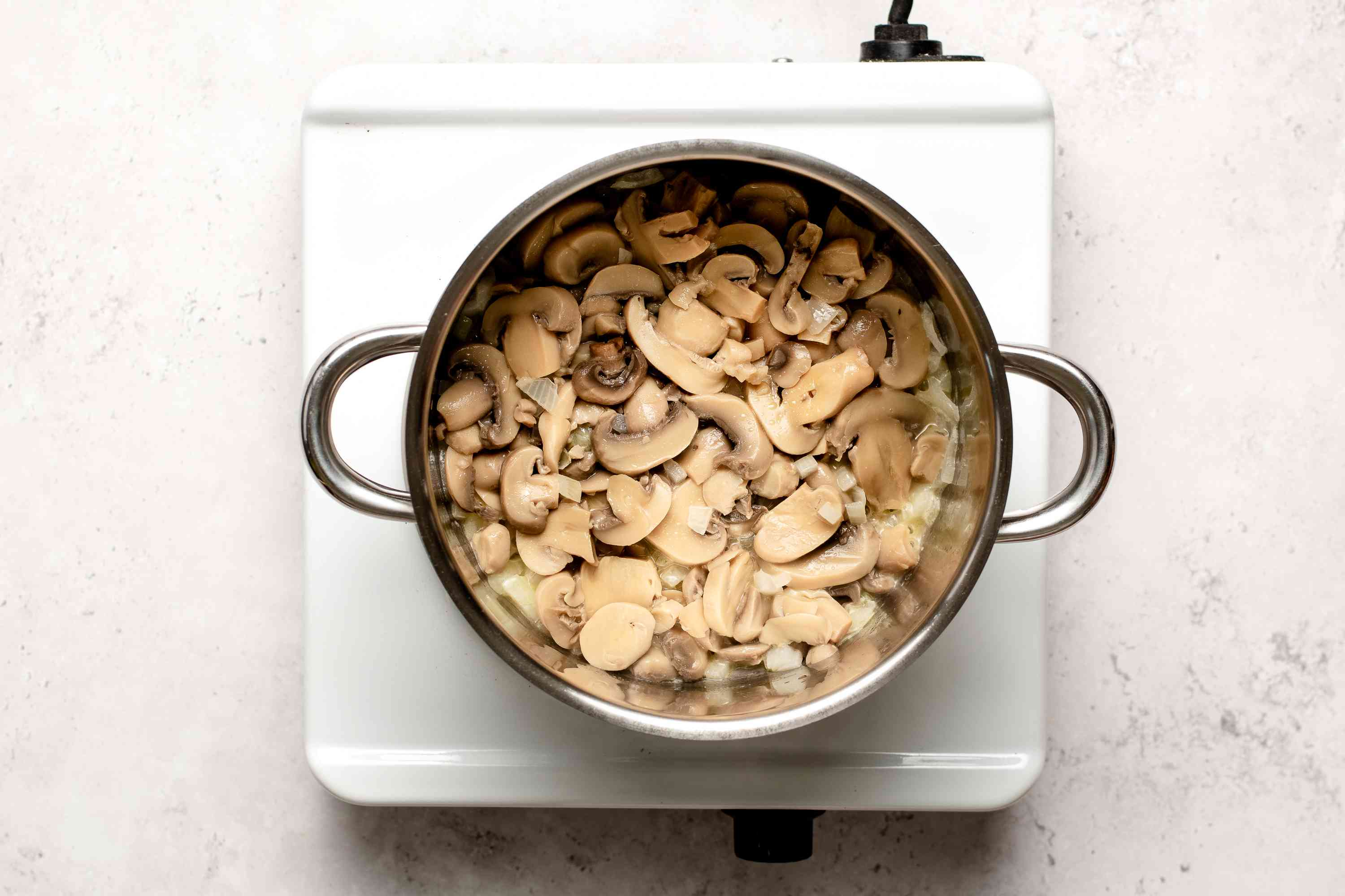butter, mushrooms and onions in a pot