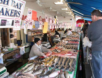Men choosing fish at a fish market