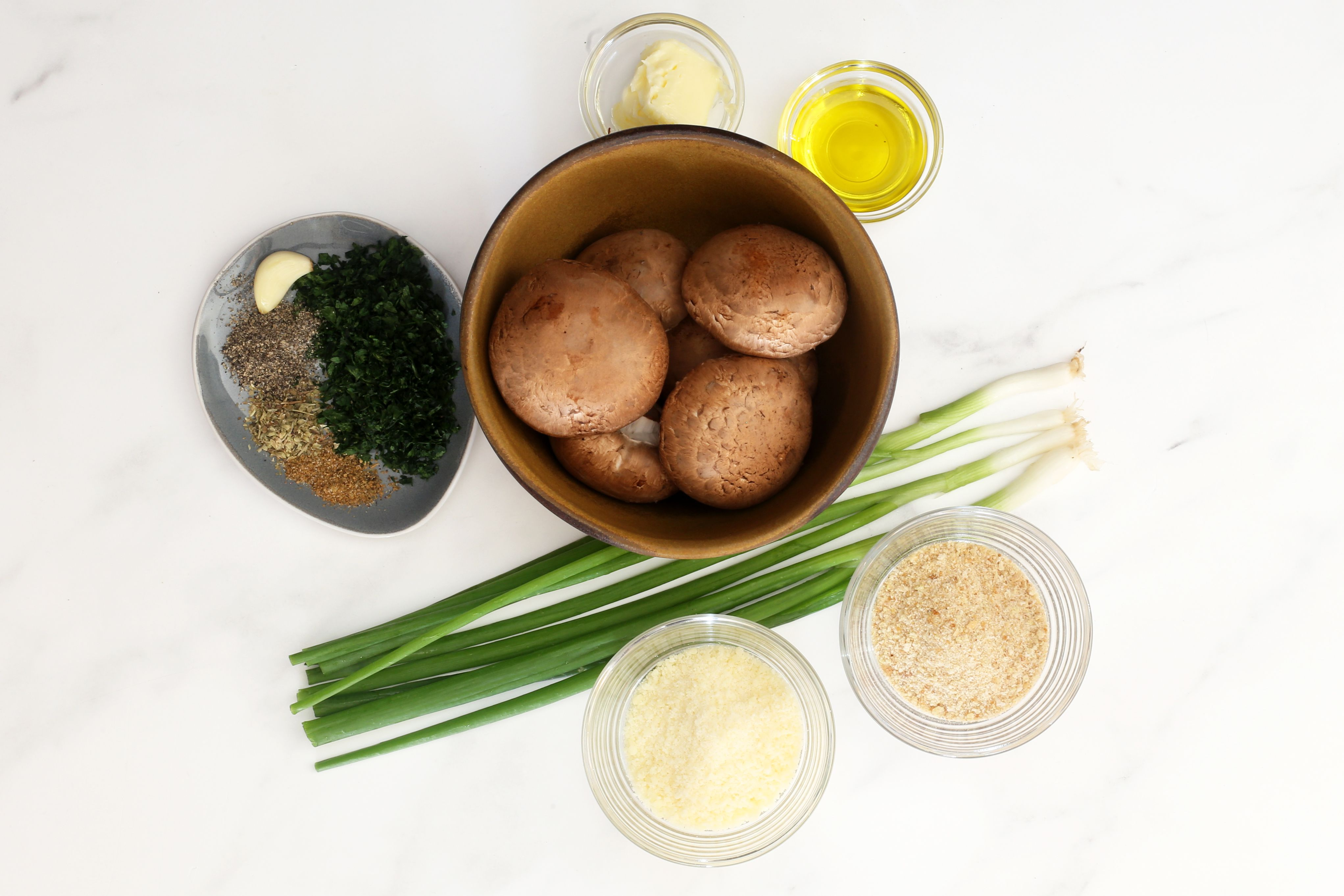 Gather the ingredients for stuffed mushrooms.