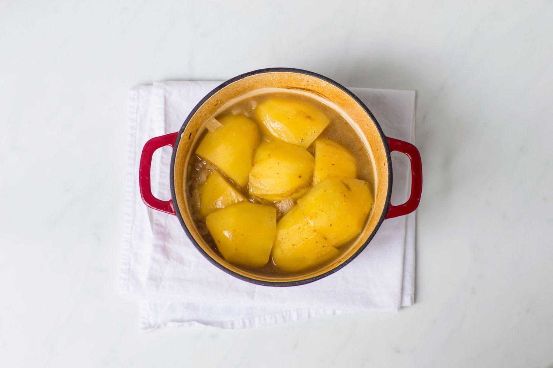 Potato layer in Scottish stovies in a Dutch oven