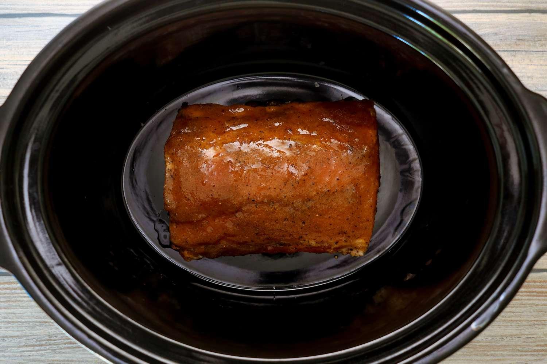 Spread brown sugar mixture on pork loin.