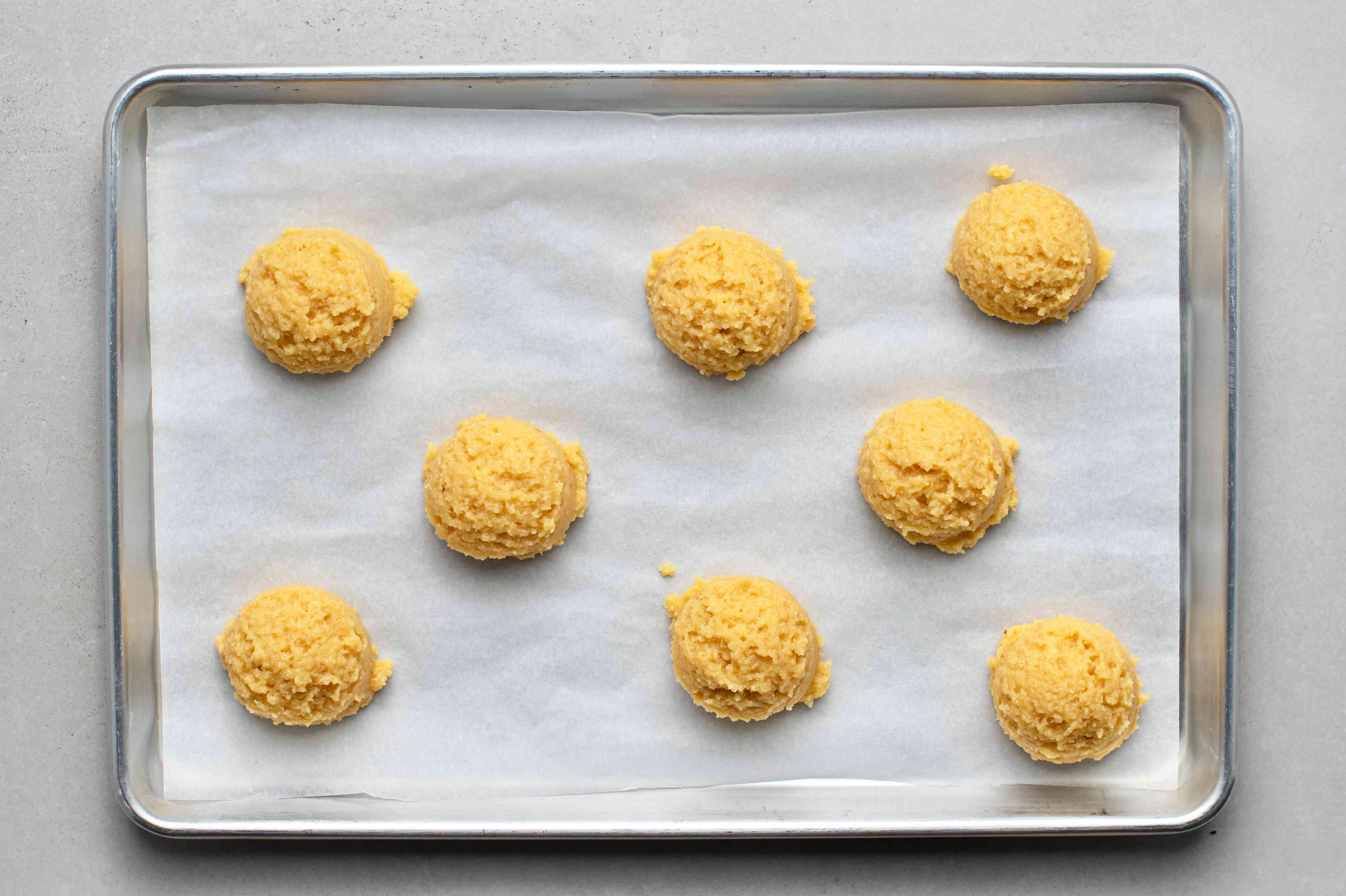 Drop large spoonfuls of dough mixture onto a flat baking sheet lined with parchment paper