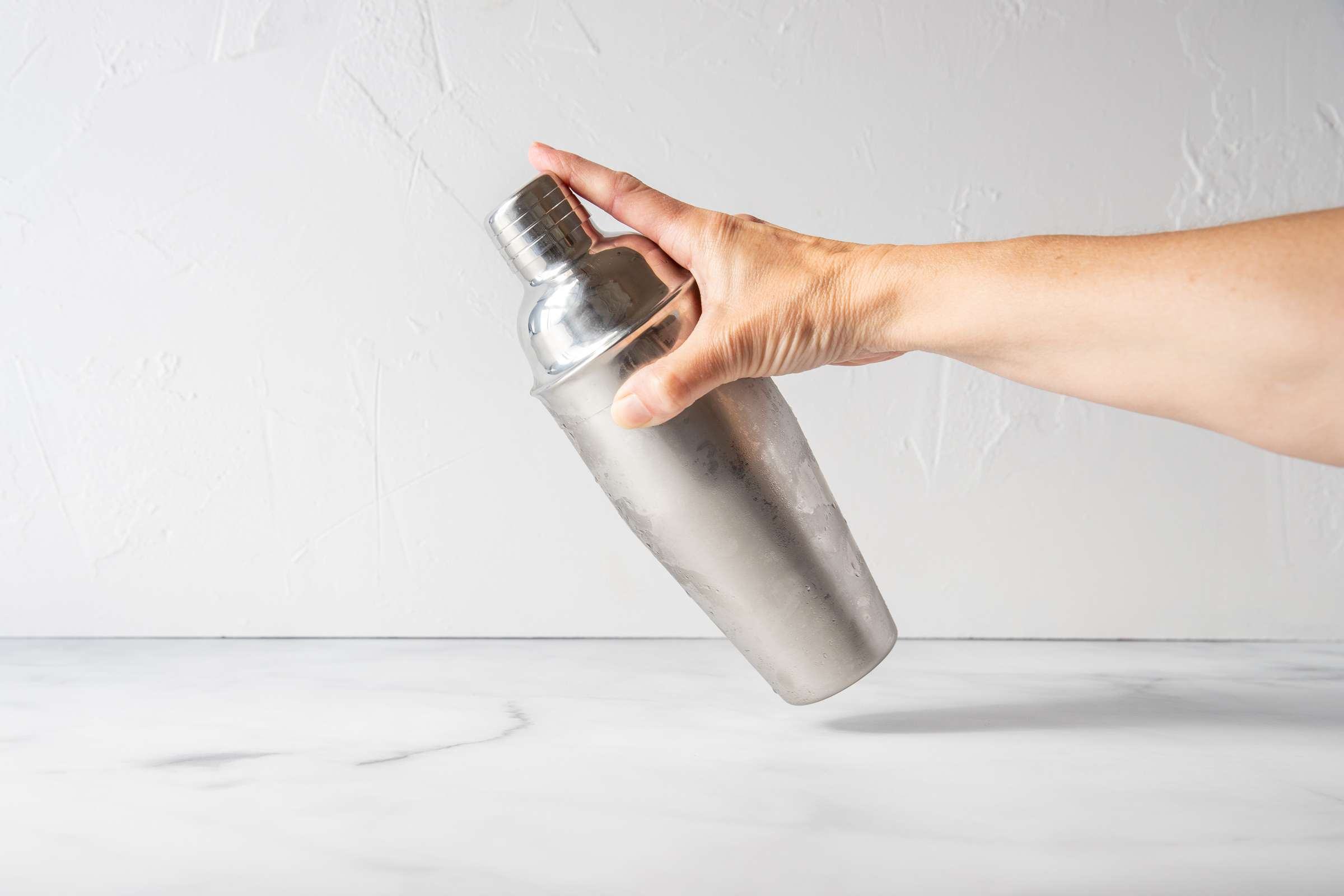 shake a cocktail shaker