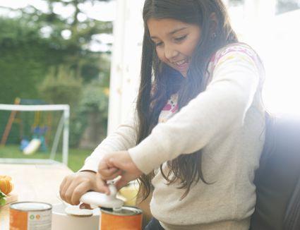 girl using can opener