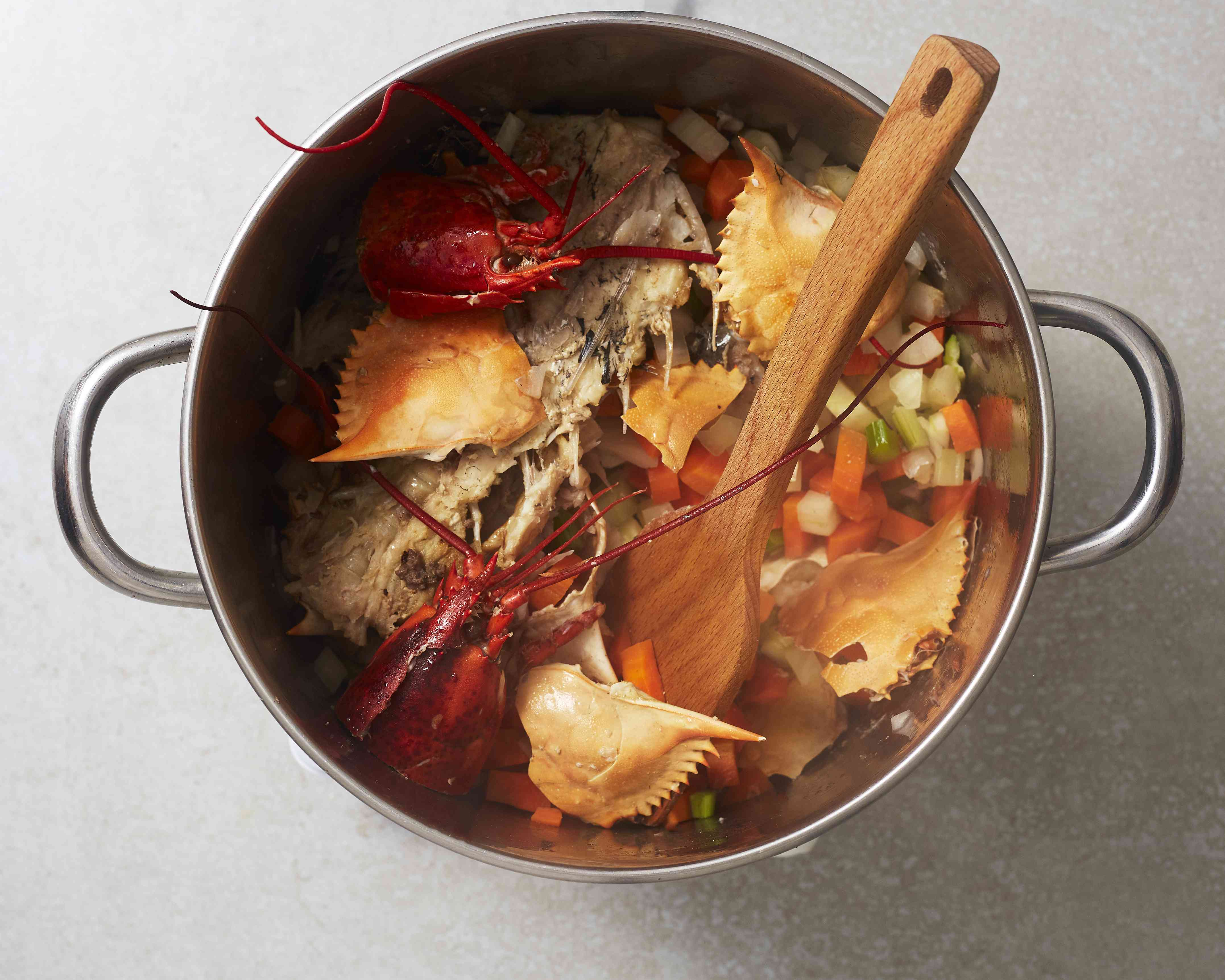 simmer the fish and vegetable mixture in the pot