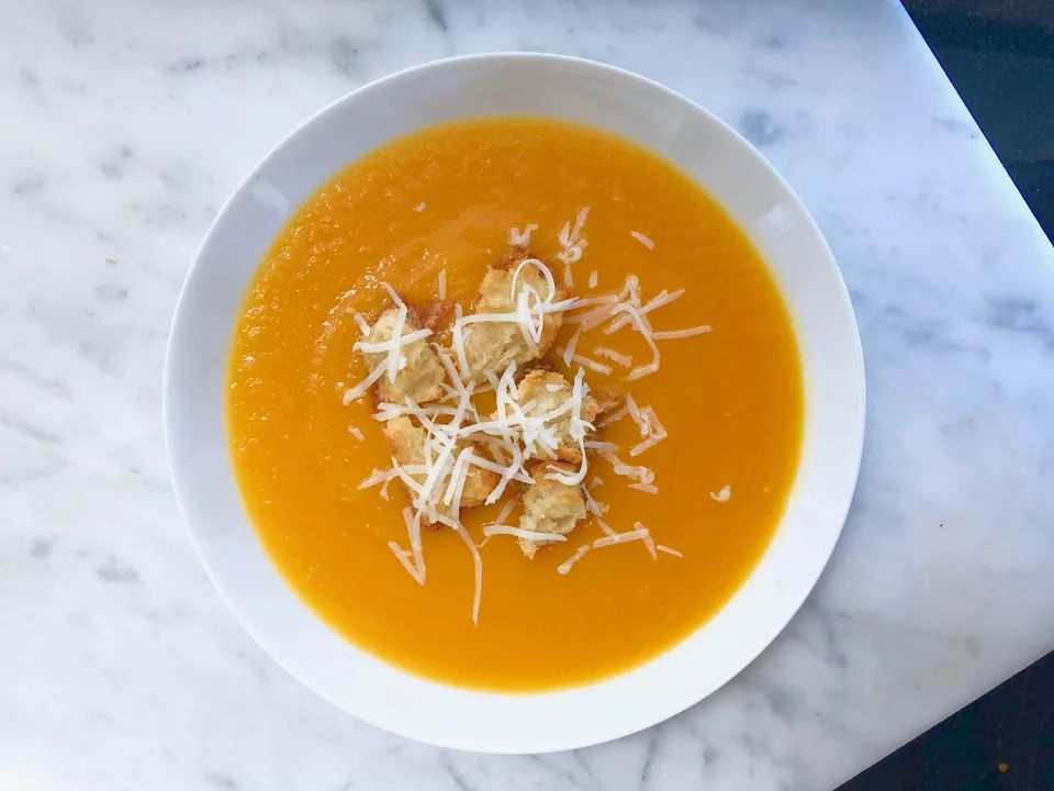Winter Squash Soup With Shredded Cheese