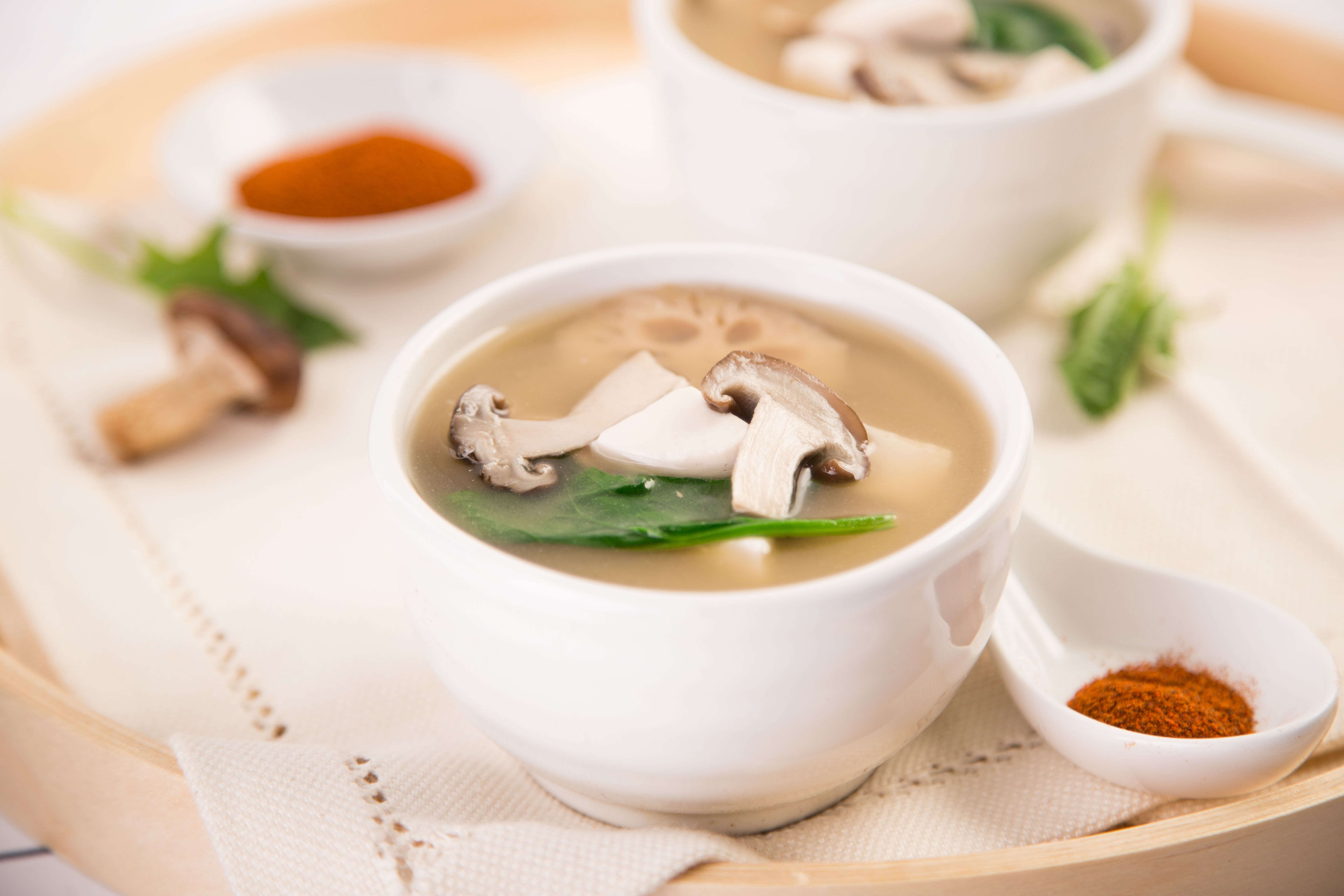 Close-Up Of Miso Soup With Mushrooms And Tofu On Table