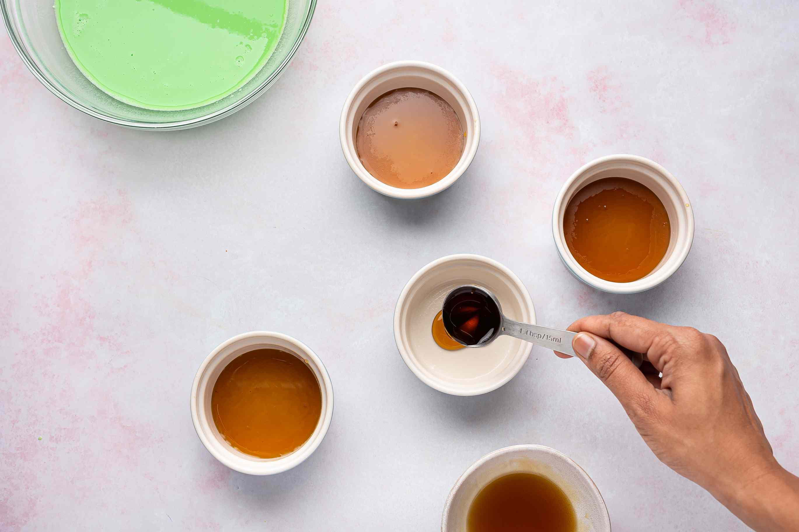 Pour a little syrup into the bottom of each ramekin