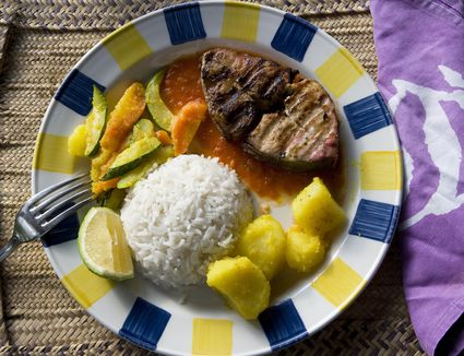 A plate of grilled shark with rice