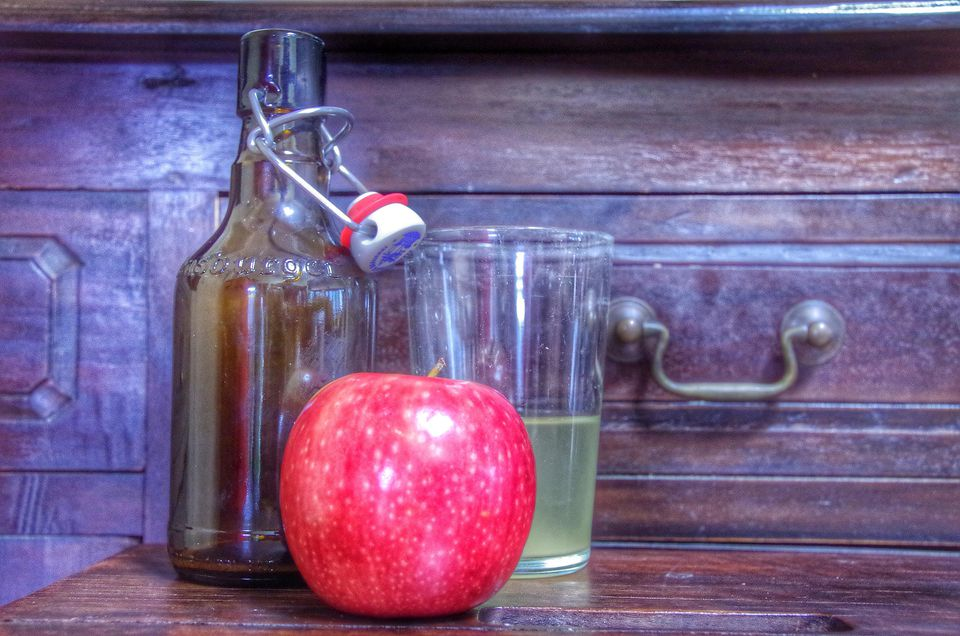 Red Apple, Bottle With Airtight Cap And Glass Of Cider On Wooden Table