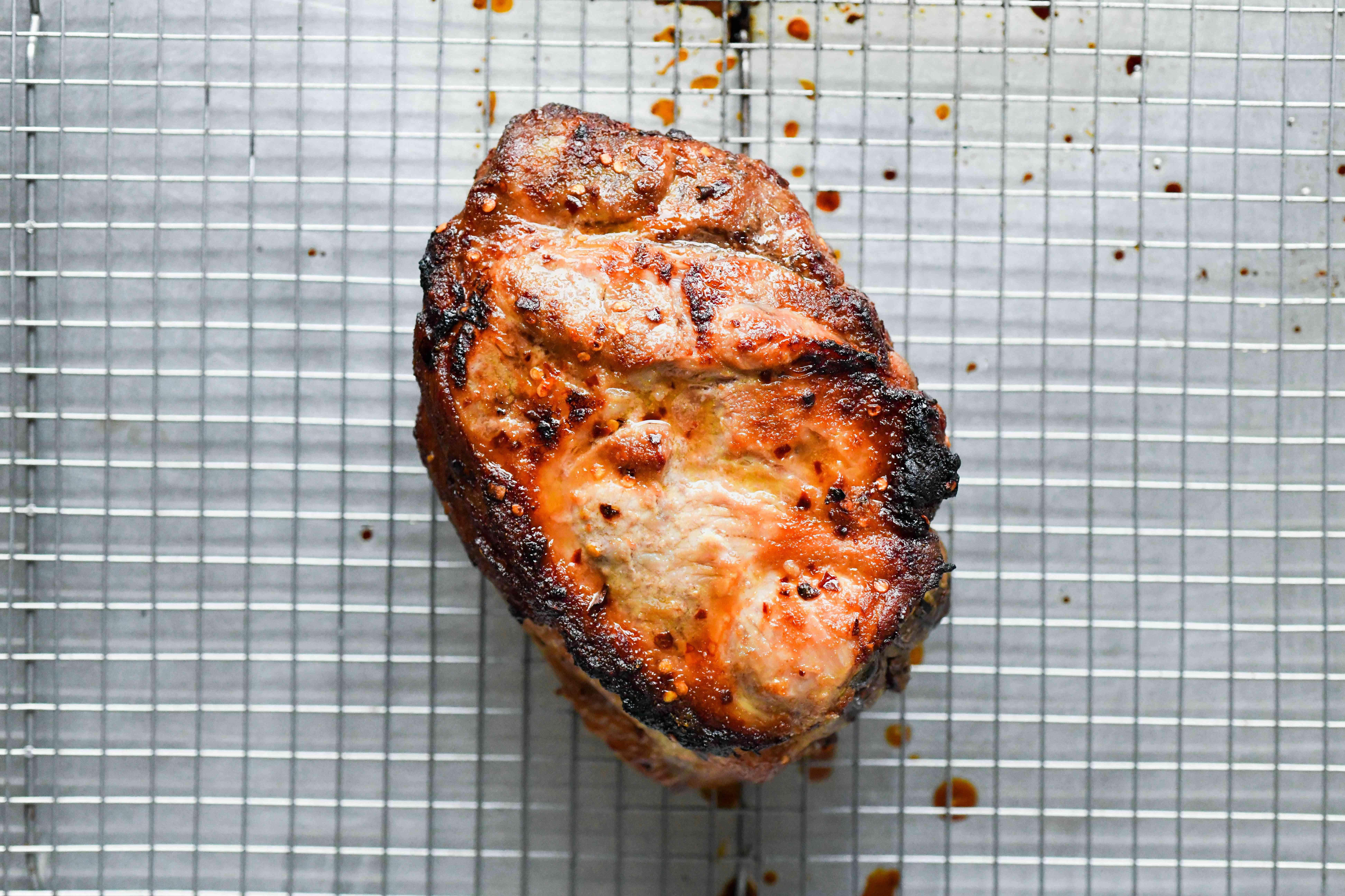 Roasted Pork shoulder on a roasting rack