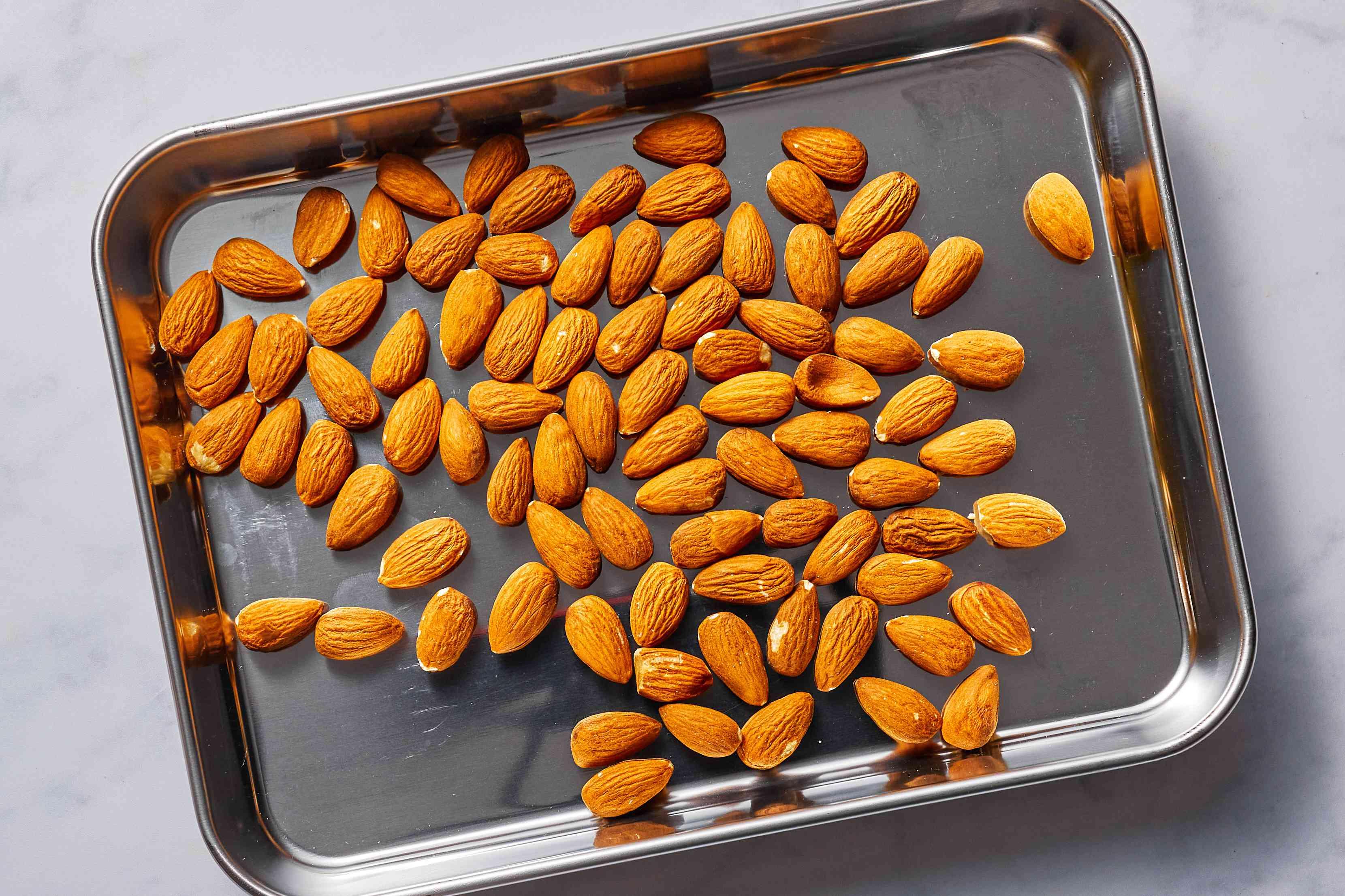 almonds on a baking sheet