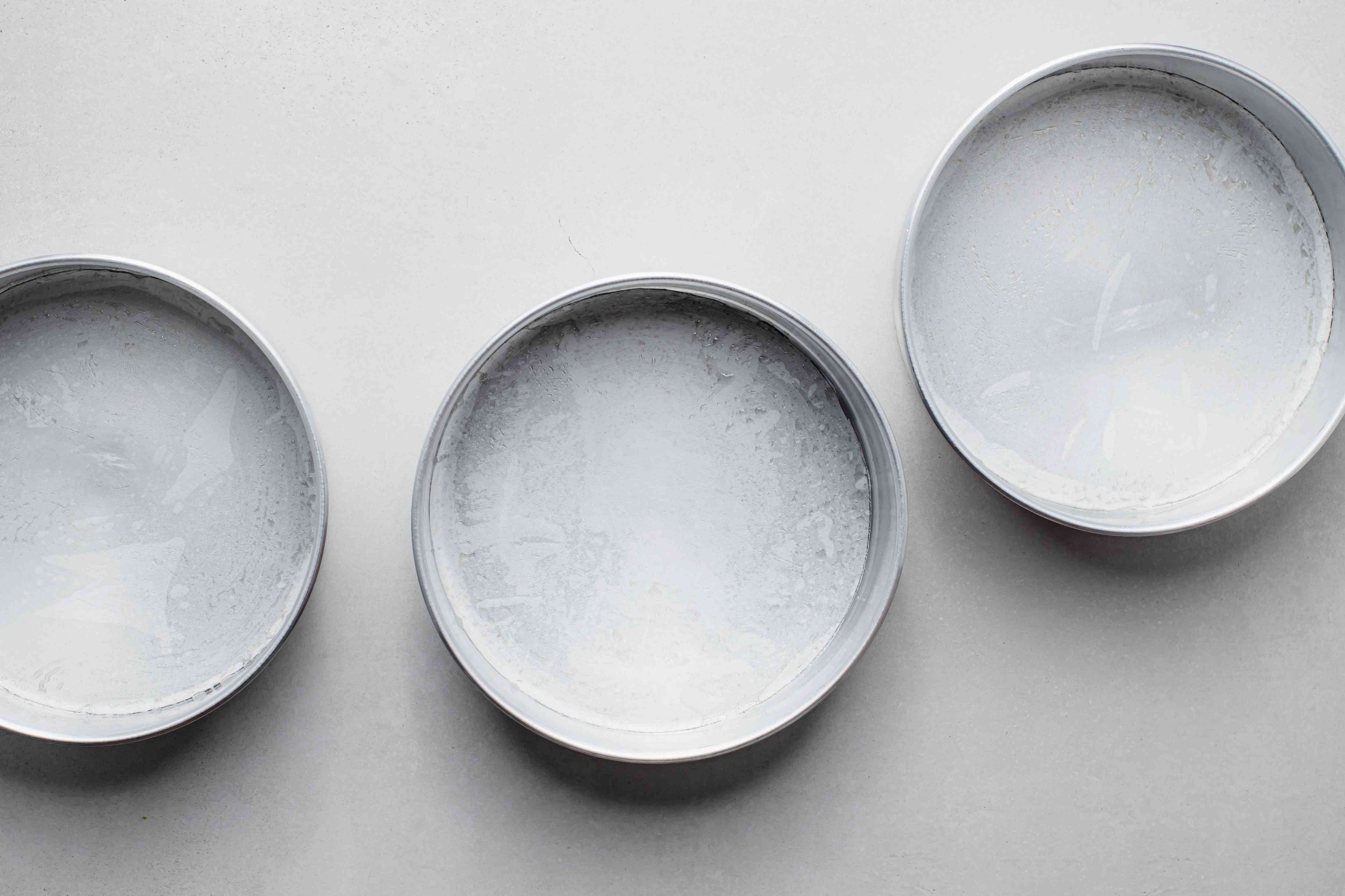 3 tube pans greased with cooking spray and parchment circle on the bottom