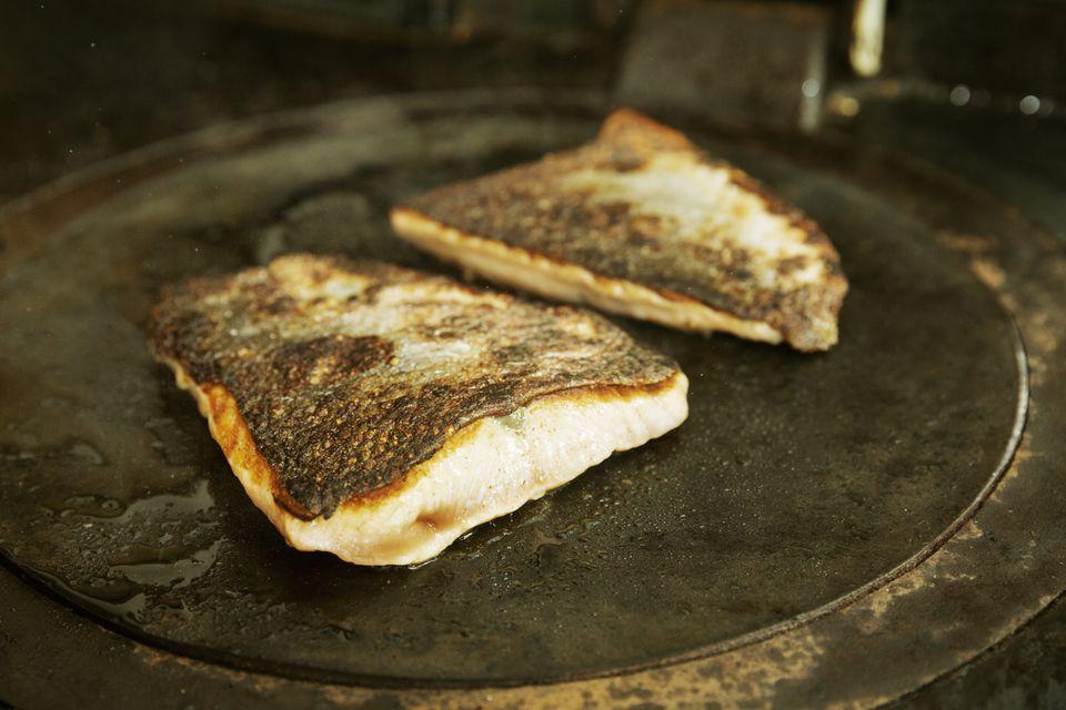 fish being pan fried