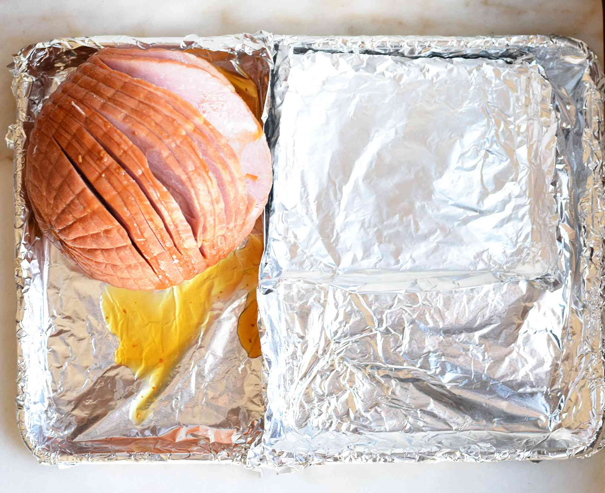 Ham on a sheet pan lined with foil
