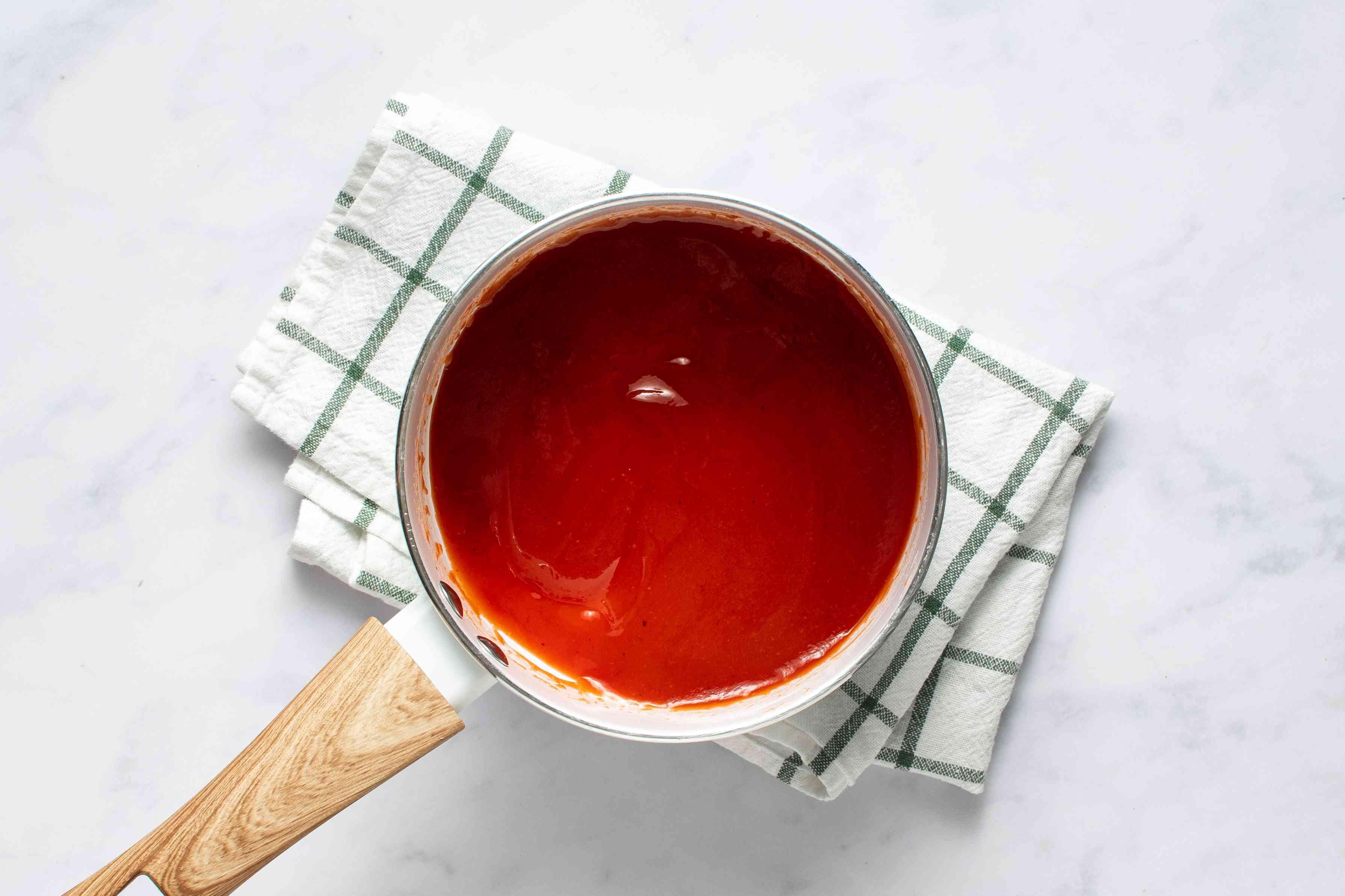 guava dipping sauce in a saucepan