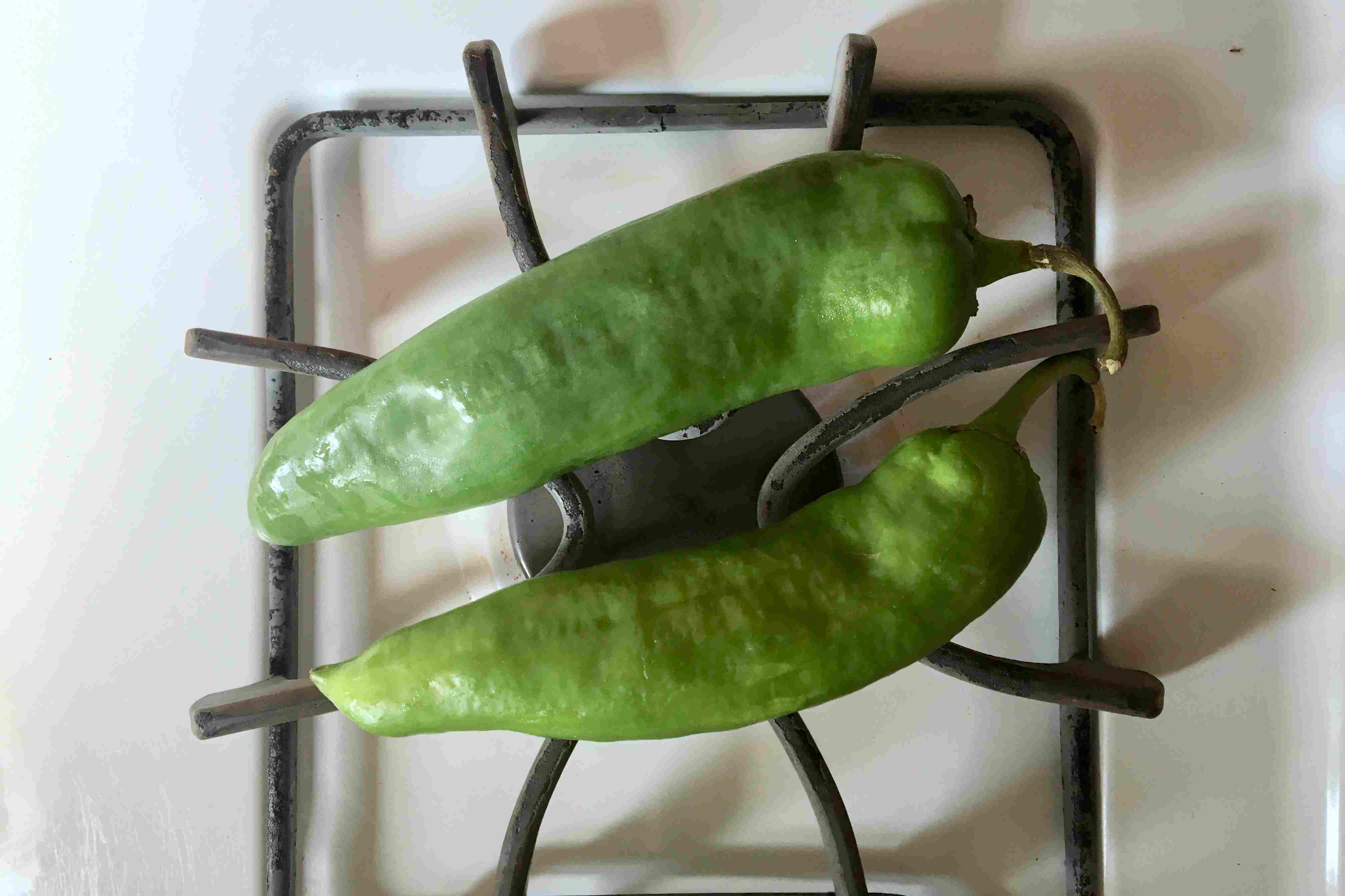 Green chiles over a burner