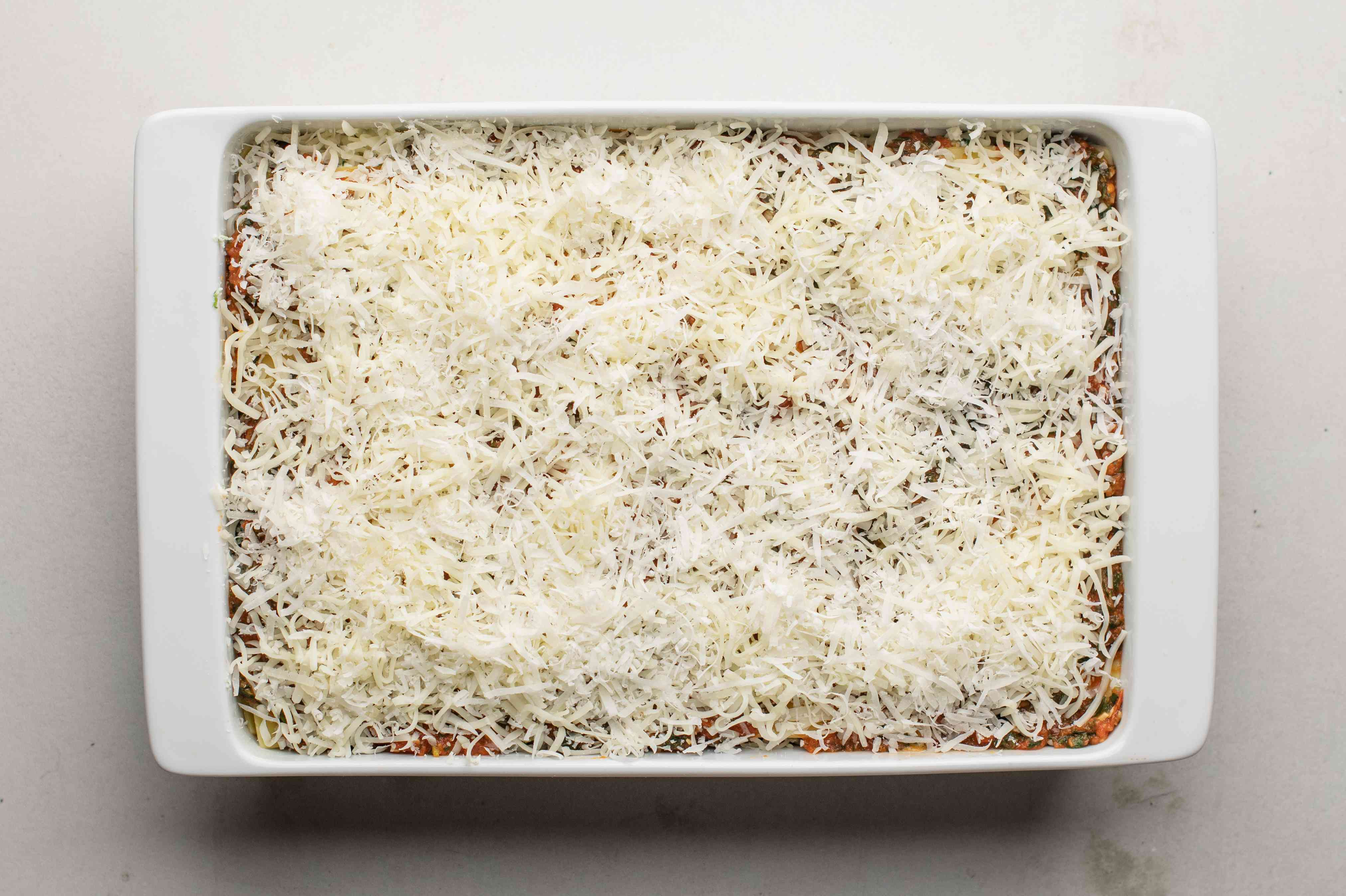 Top with another layer of noodles and cheese for spinach lasagna