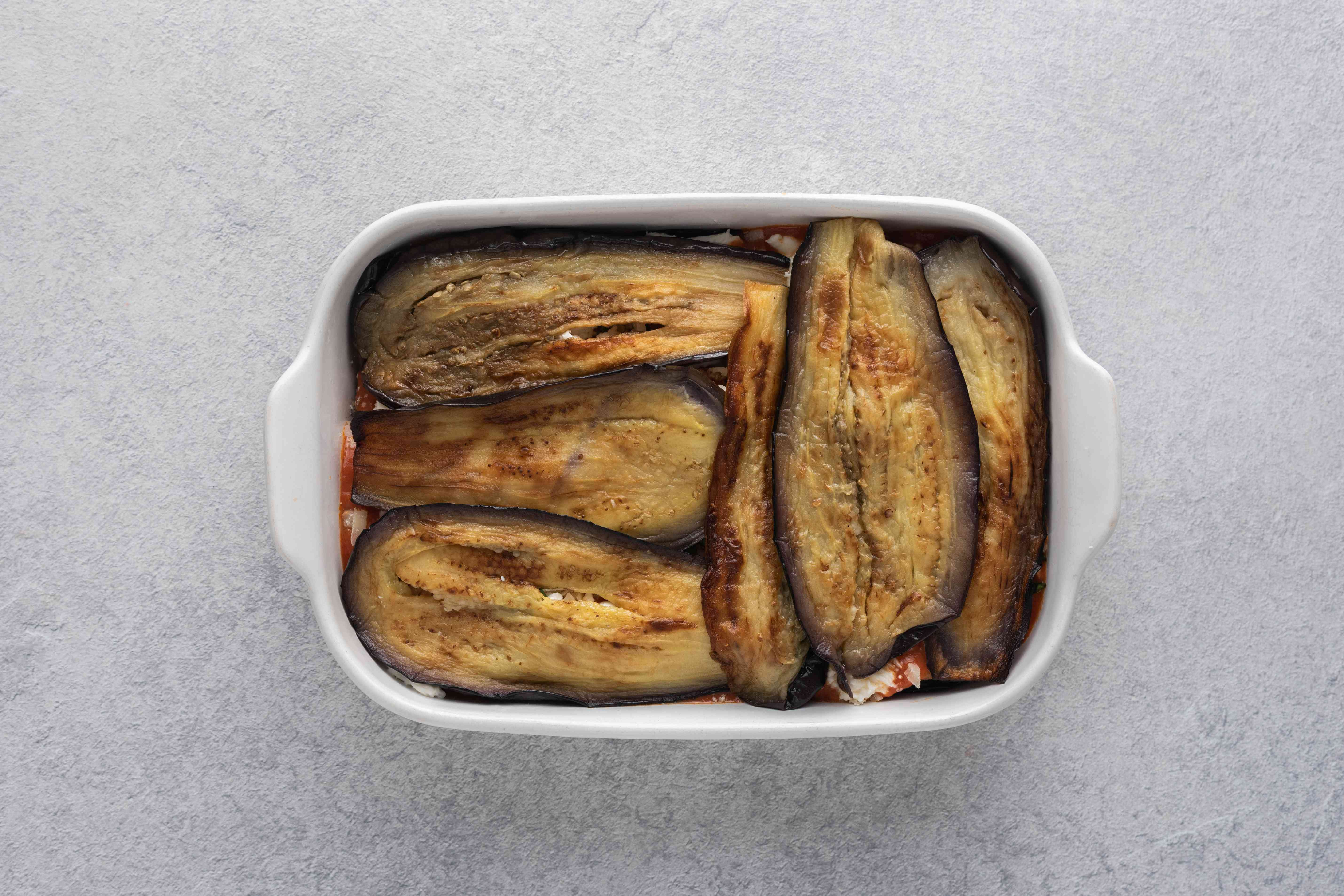 layer of fried eggplant in a baking dish