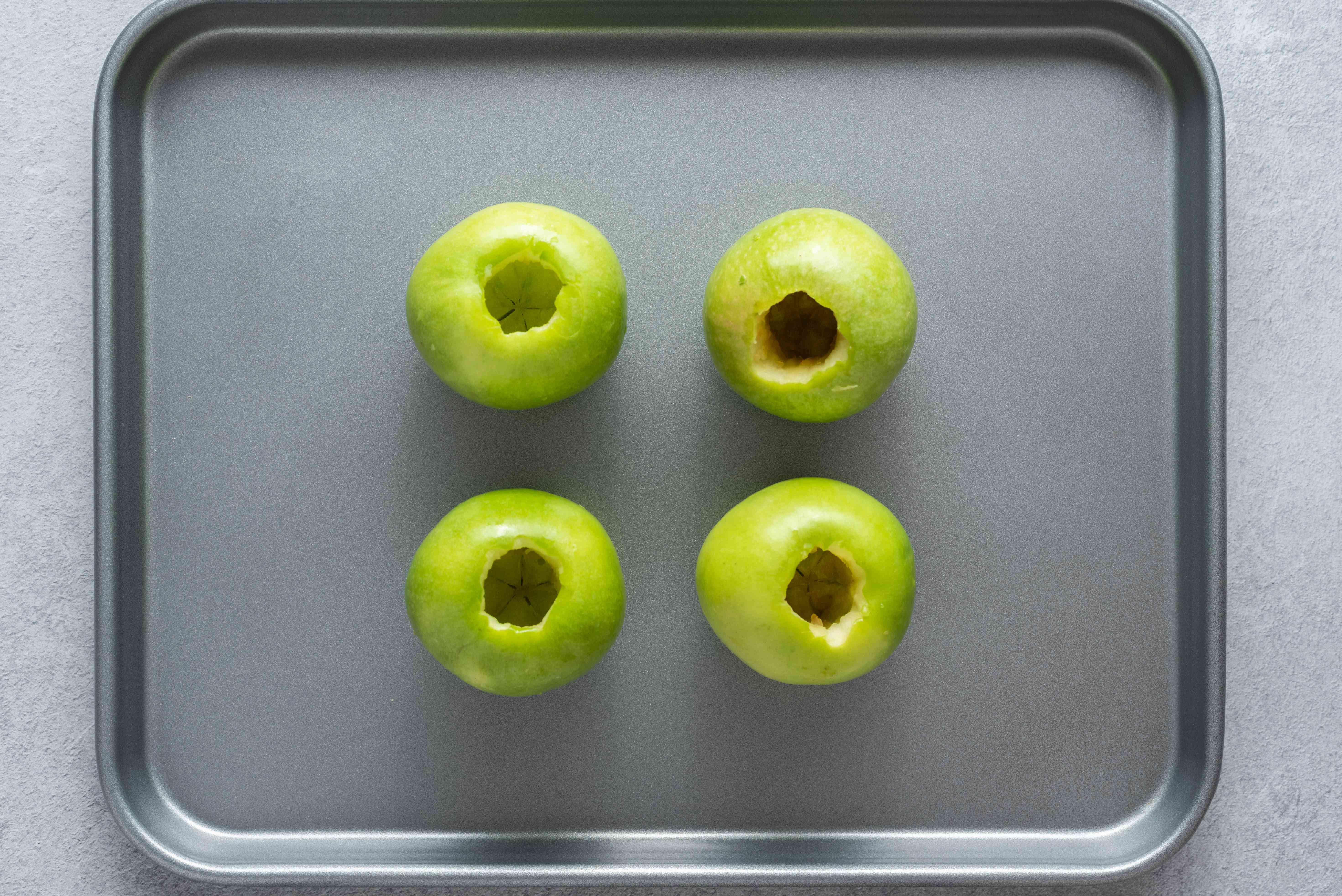 Stand the apple up on a baking sheet with the cored portion up