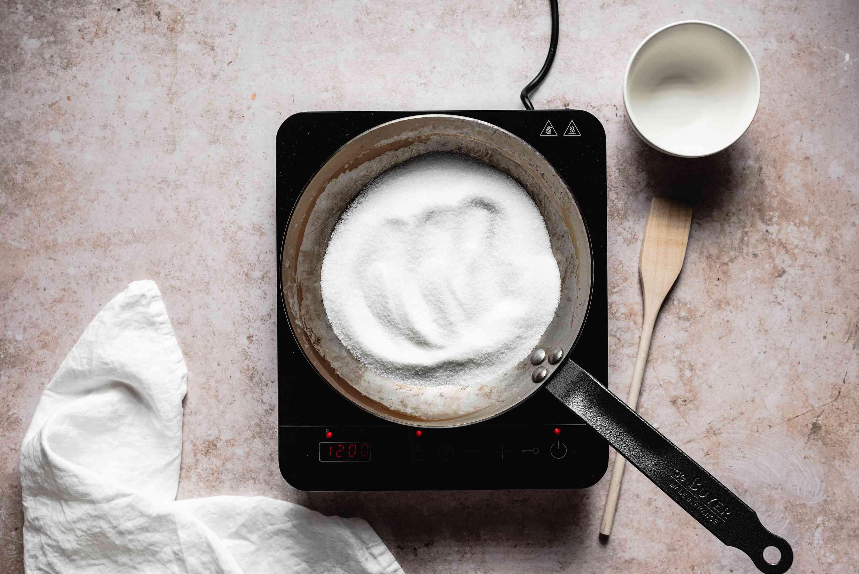Pour sugar into a warm pan