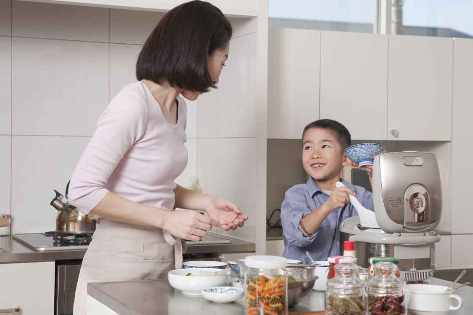 Son Serving Rice Bowl to Mother
