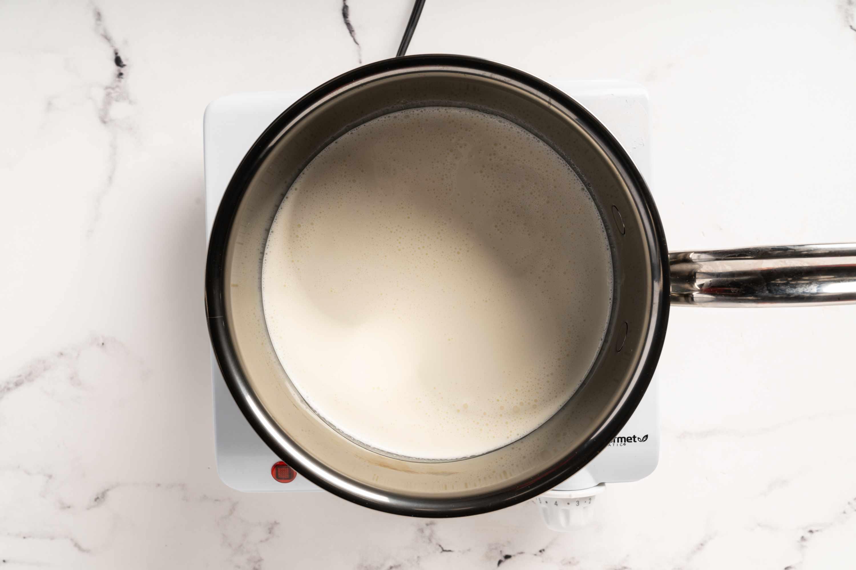 A small pot of heavy cream simmering