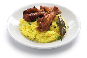 chicken and pork adobo over yellow rice, filipino food
