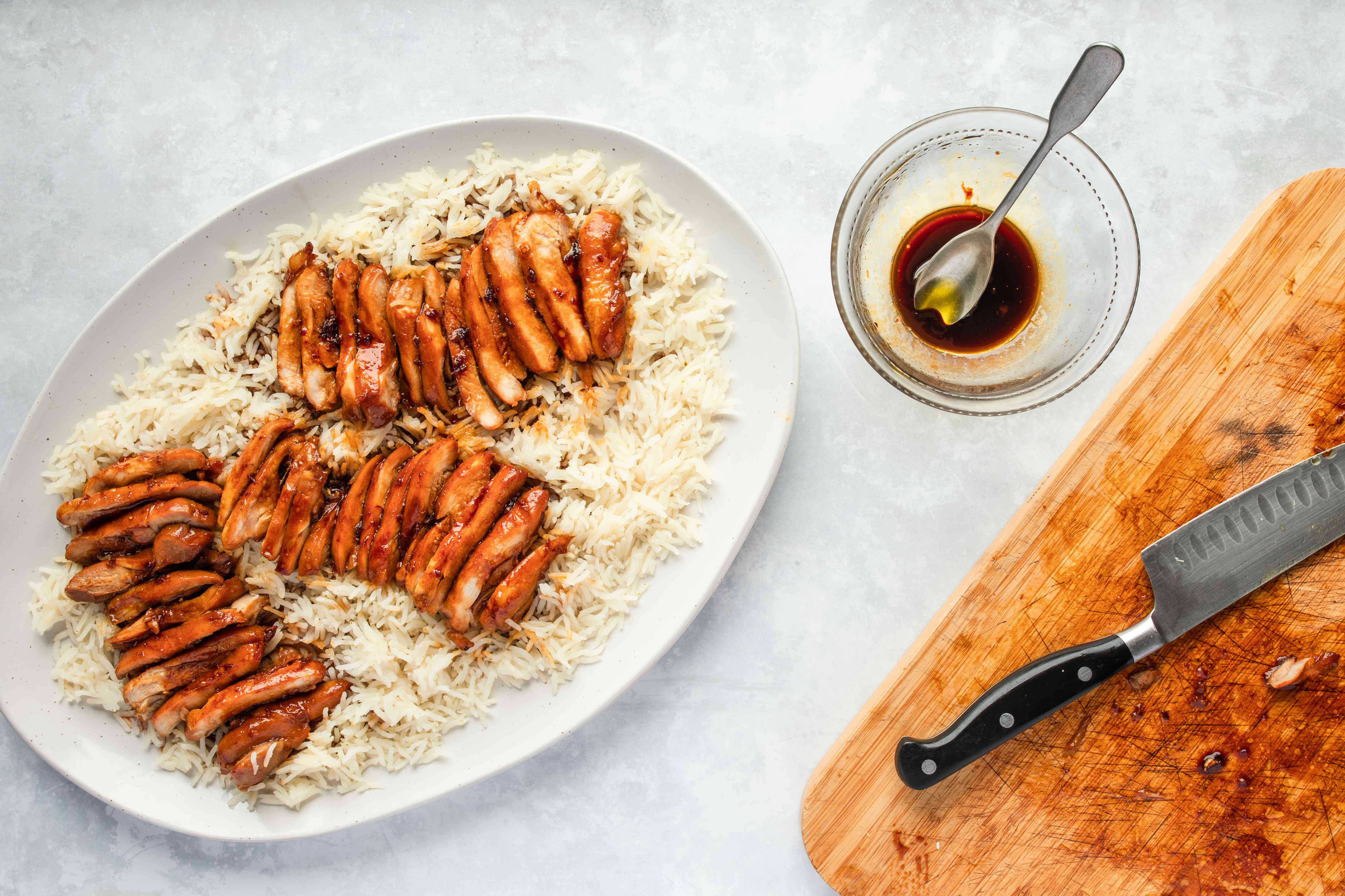 Sliced chicken served over rice with sauce