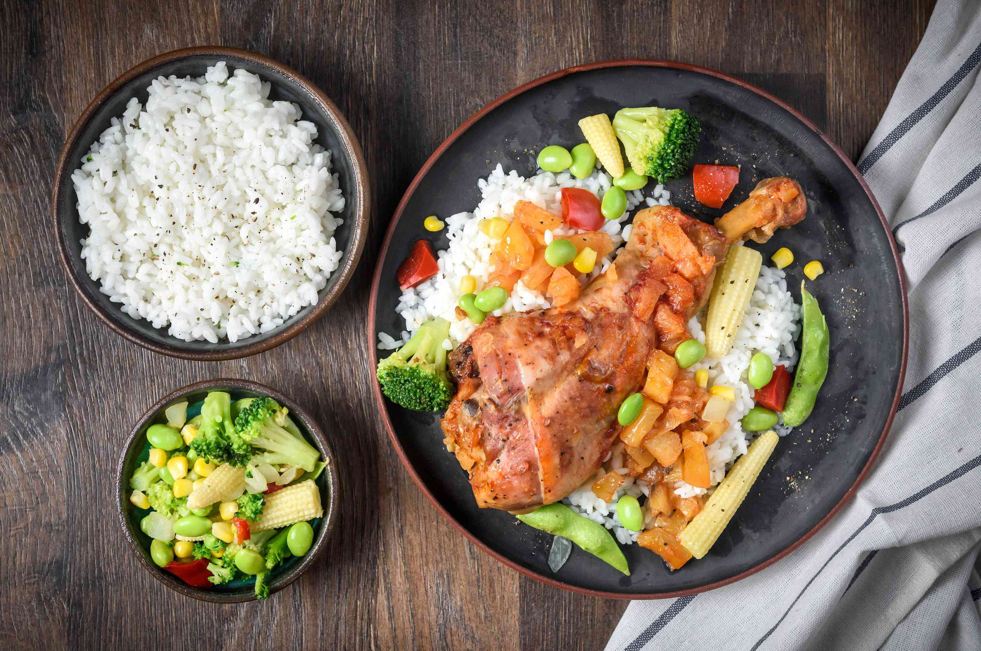 Slow cooker island barbecue turkey legs with a side of rice and vegetables