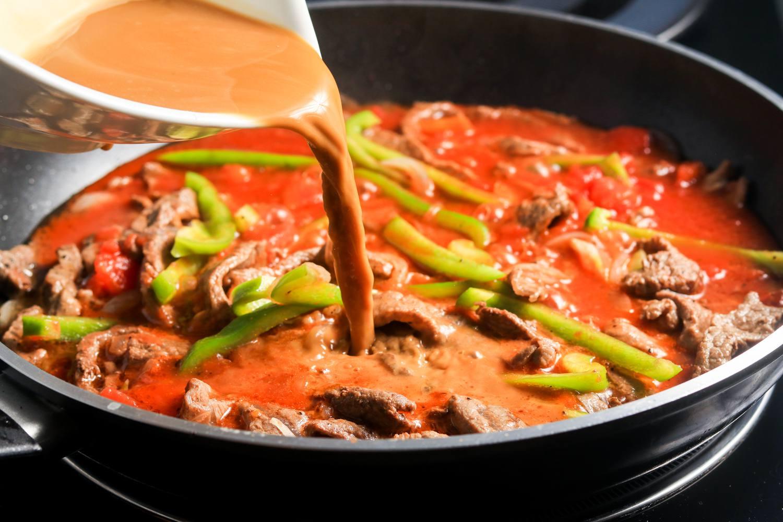 Add cornstarch mixture to beef mixture in skillet