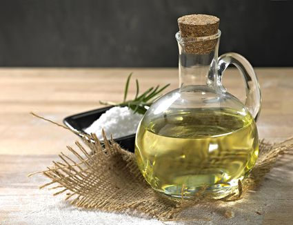 Small glass bottle containing olive oil.