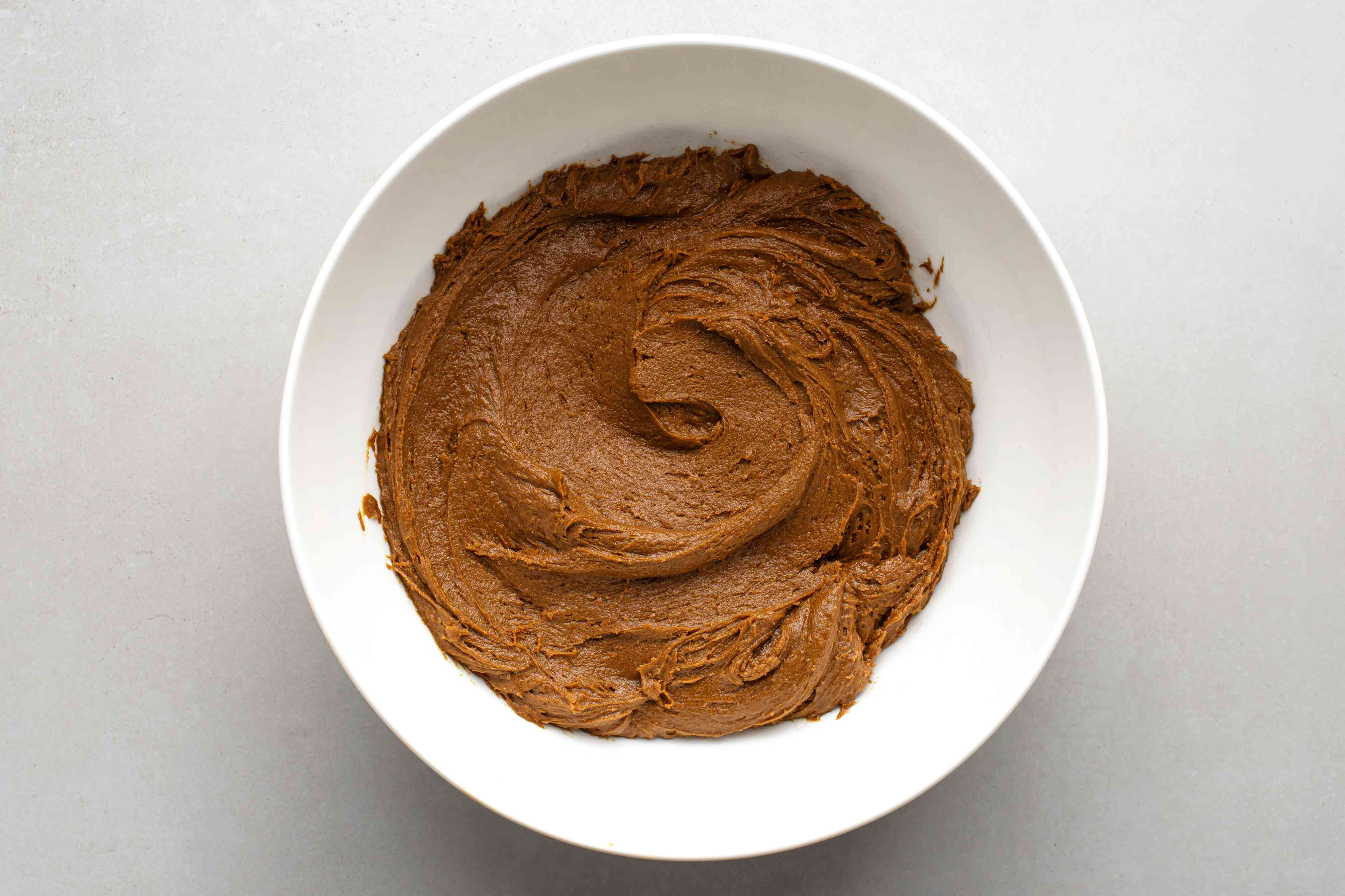 Add spices, flour, and the sour cream mixture to the molasses mixture