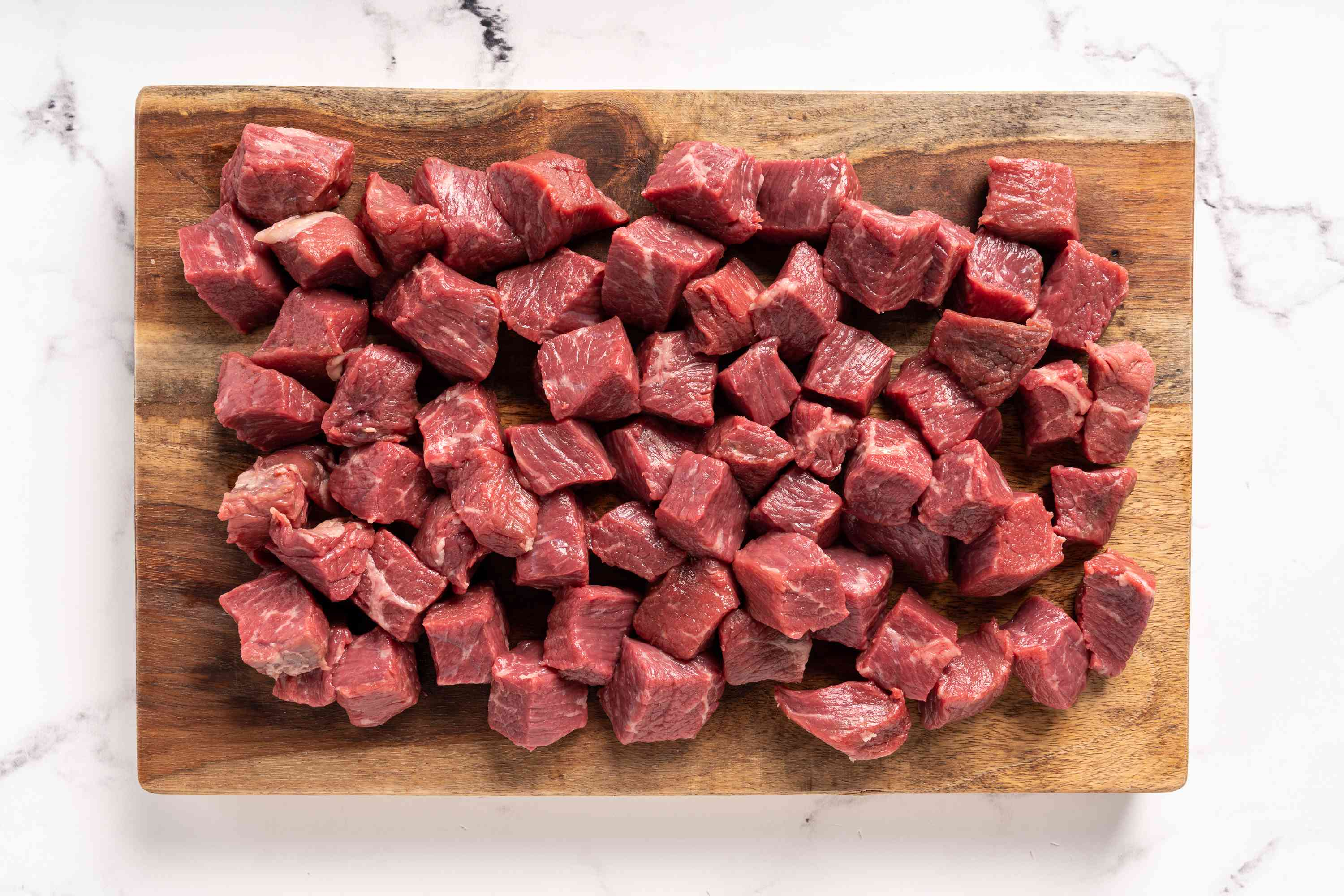 Beef cubes on a cutting board