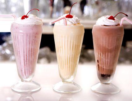 A vanilla, strawberry, and chocolate frappe milkshake