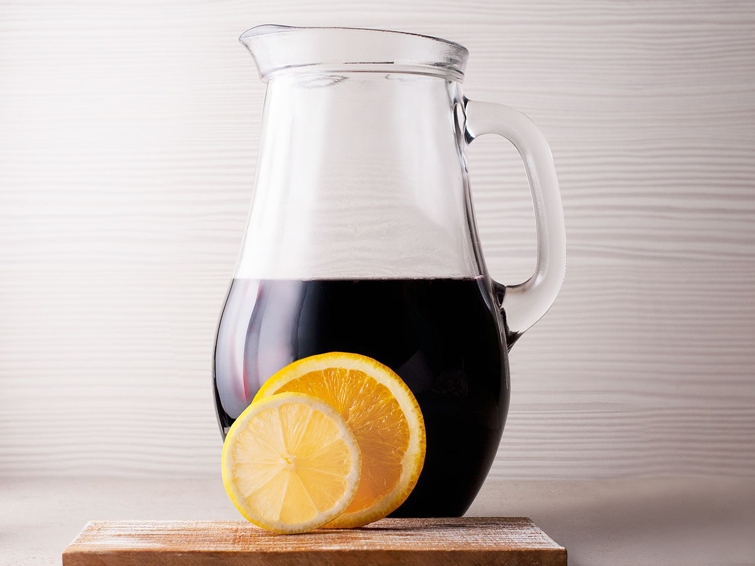 Add sangria ingredients into pitcher